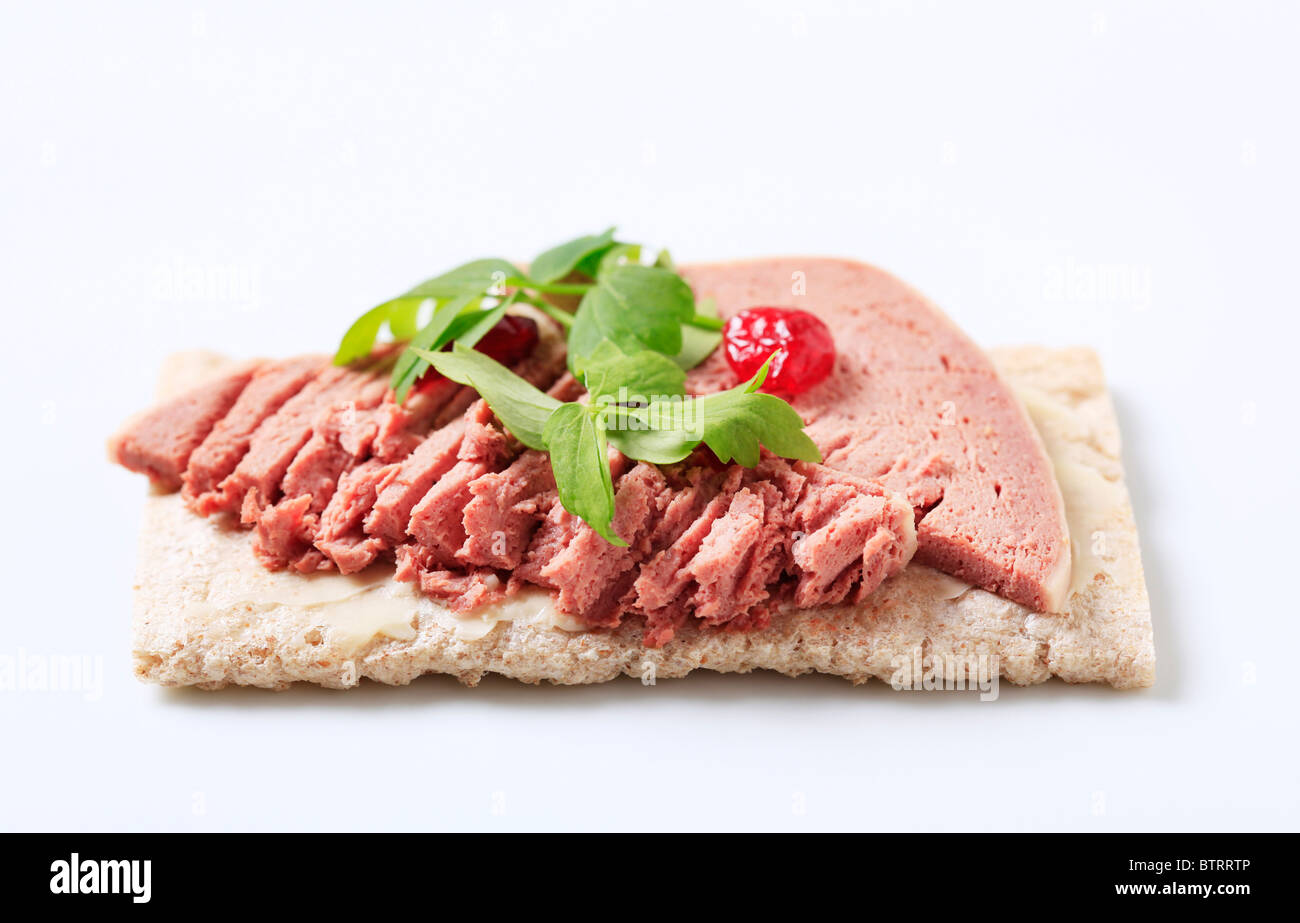 Crispbread with butter and liver pate - studio - Stock Image