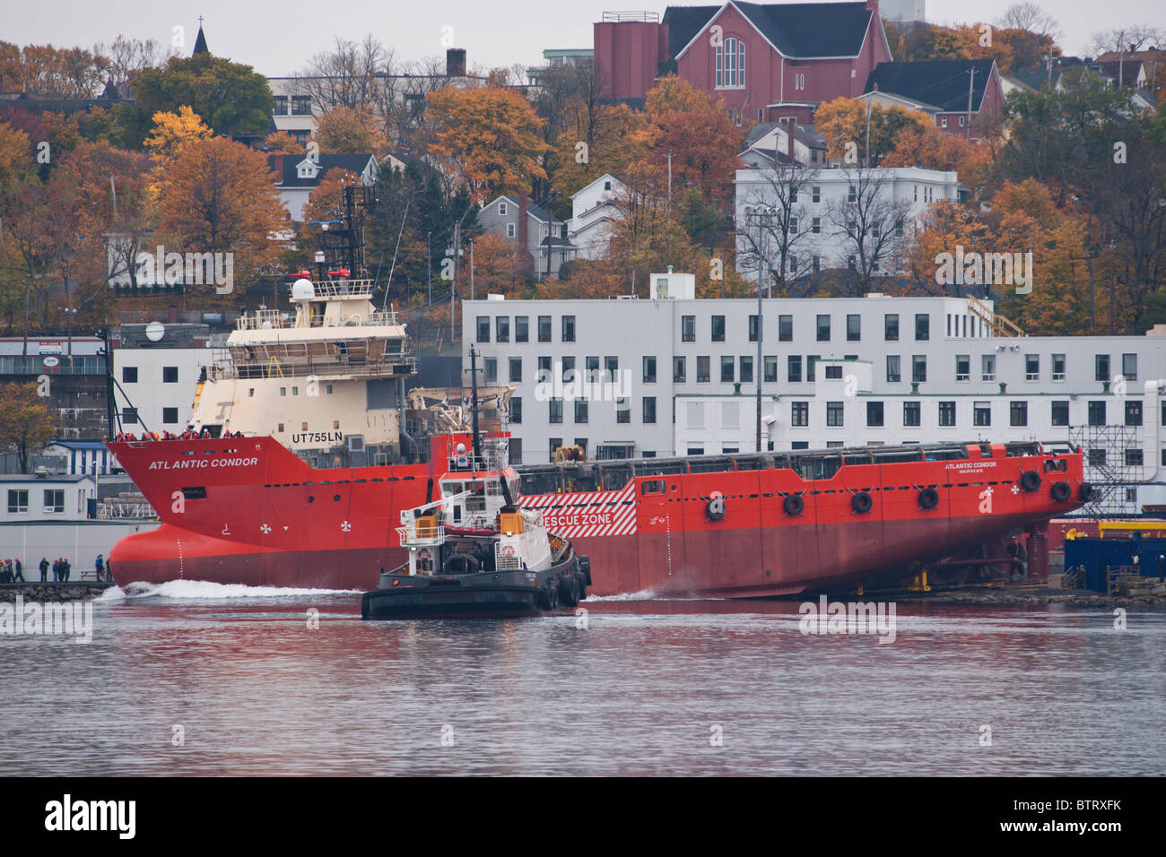 The rig supplier Atlantic Condor is launched down the ways at the Halifax Shipyard in Nova Scotia, Canada. - Stock Image