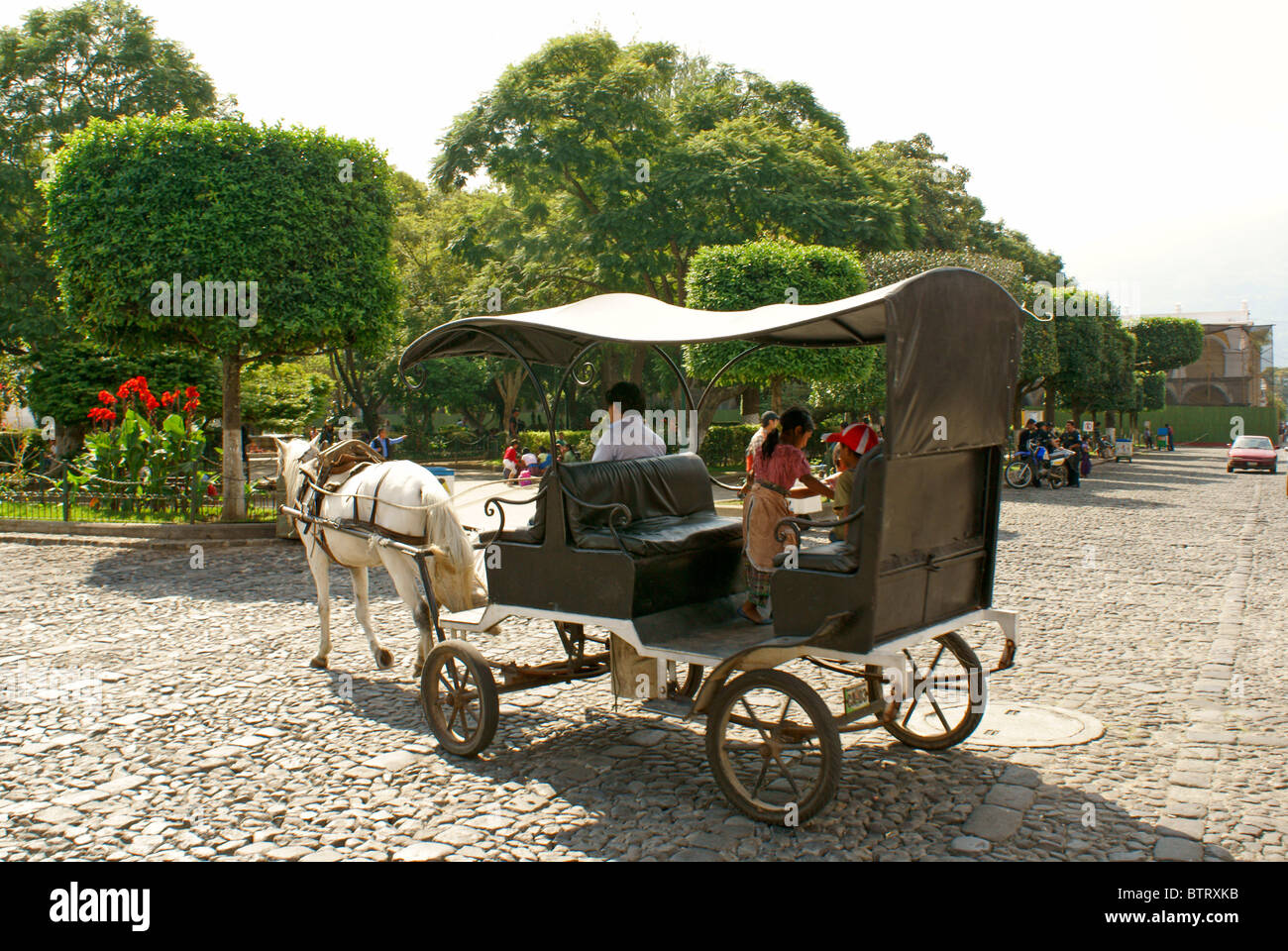 Horse and carriage in Antigua, Guatemala. Antigua is a UNESCO World heritage site. - Stock Image