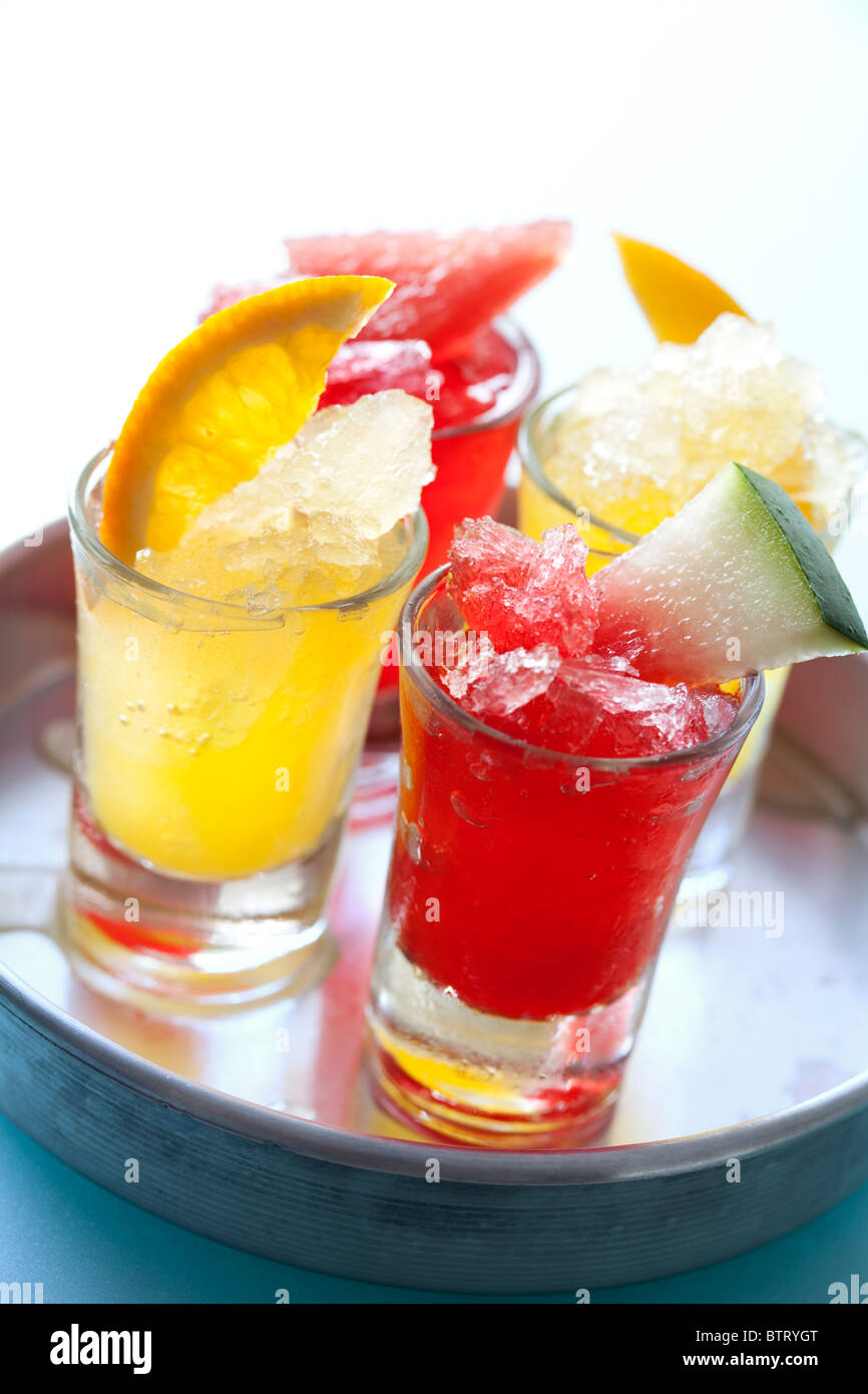 colourful icy fruit drinks on a tray - Stock Image