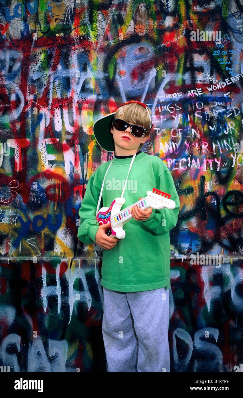 U2 Wall, Dublin, Co Dublin, Ireland, Boy Holding A Toy Guitar - Stock Image