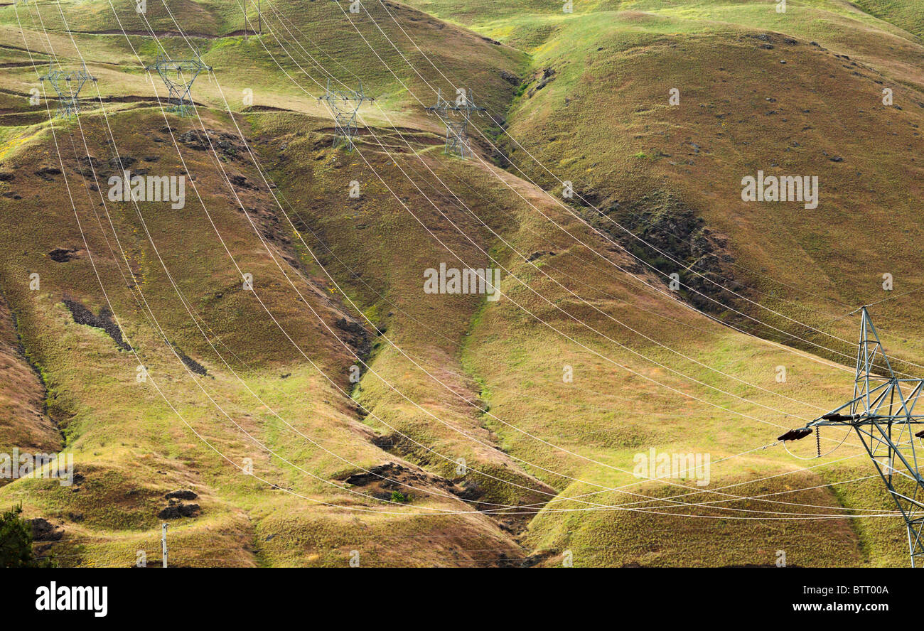 High voltage power lines running down a hillside in Eastern Washington, USA. - Stock Image