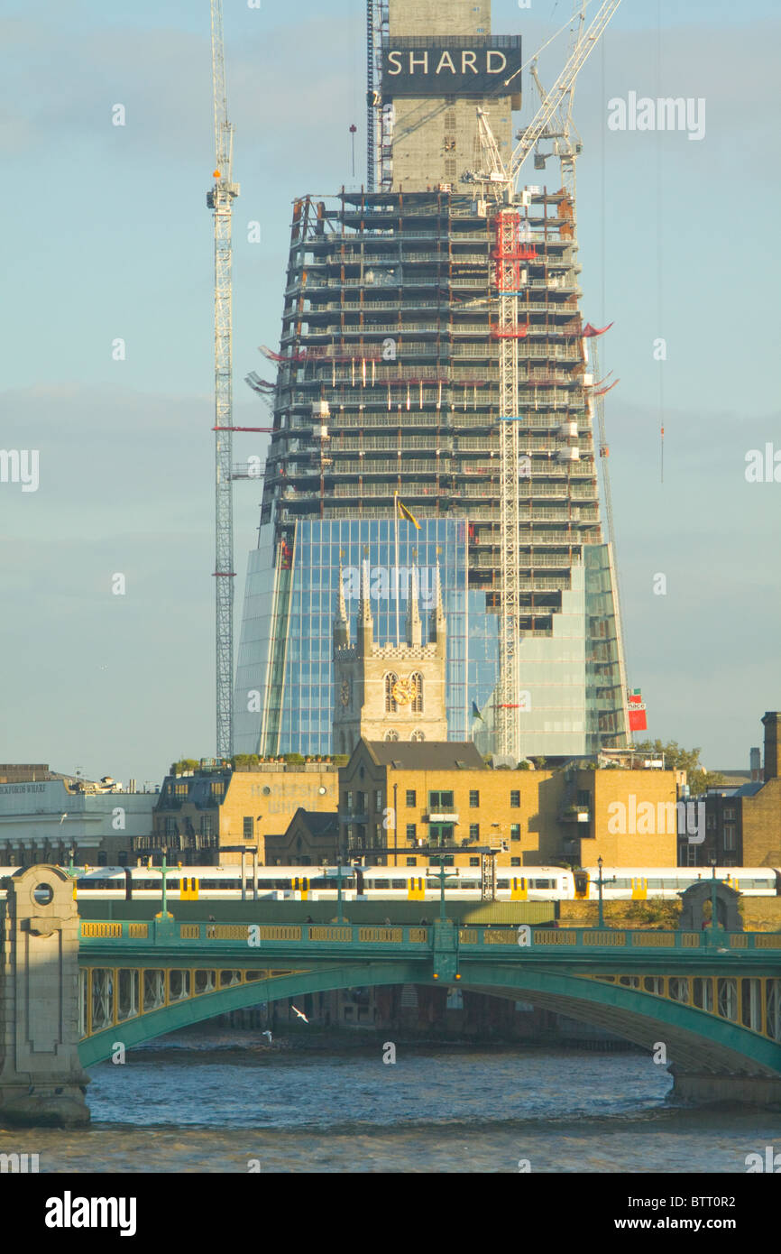 The Shard of Glass under construction, dwarfing Southwark Cathedral - Stock Image