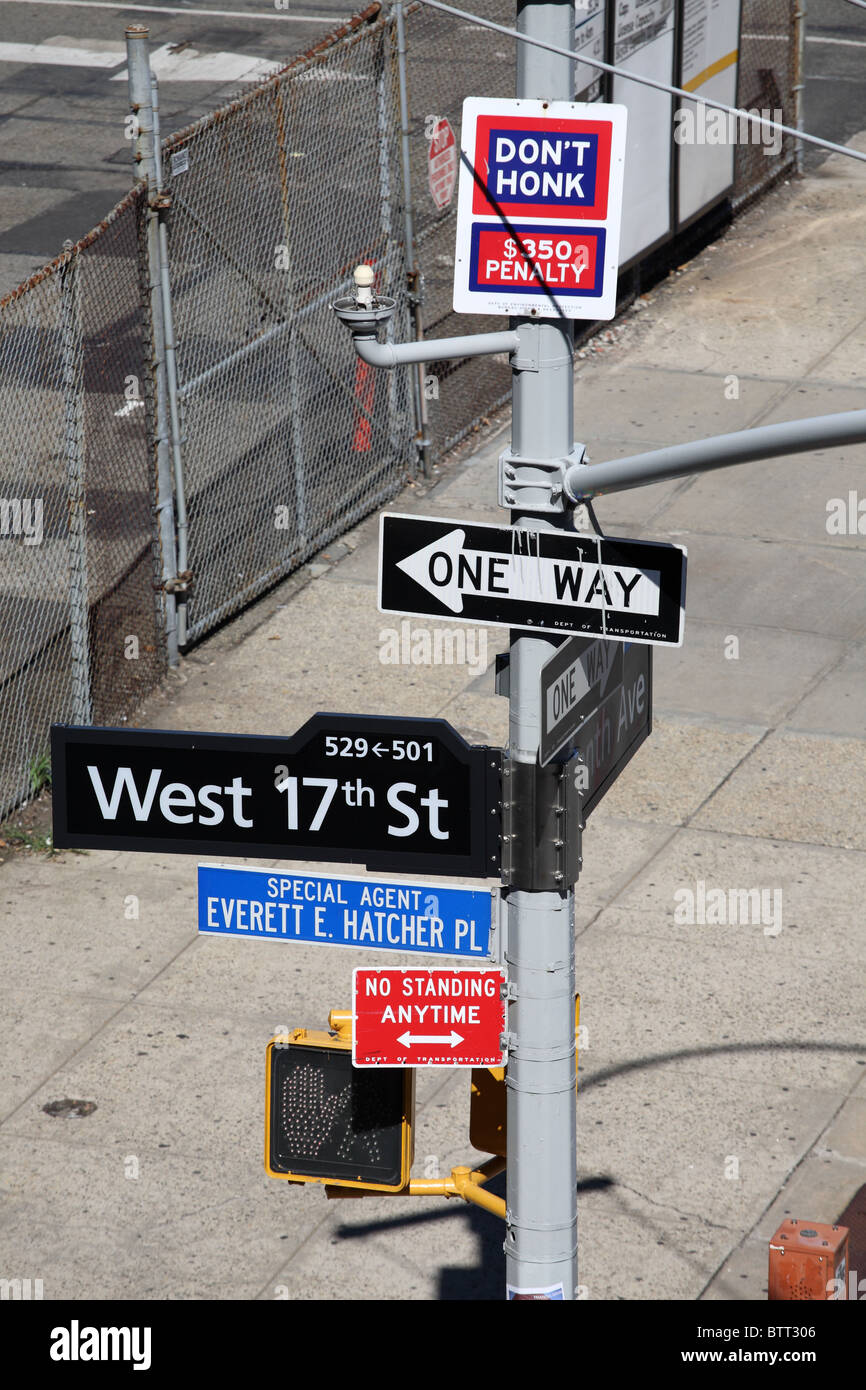 Street signs on a post seen from the New York High Line public park, West Chelsea, Manhattan. - Stock Image