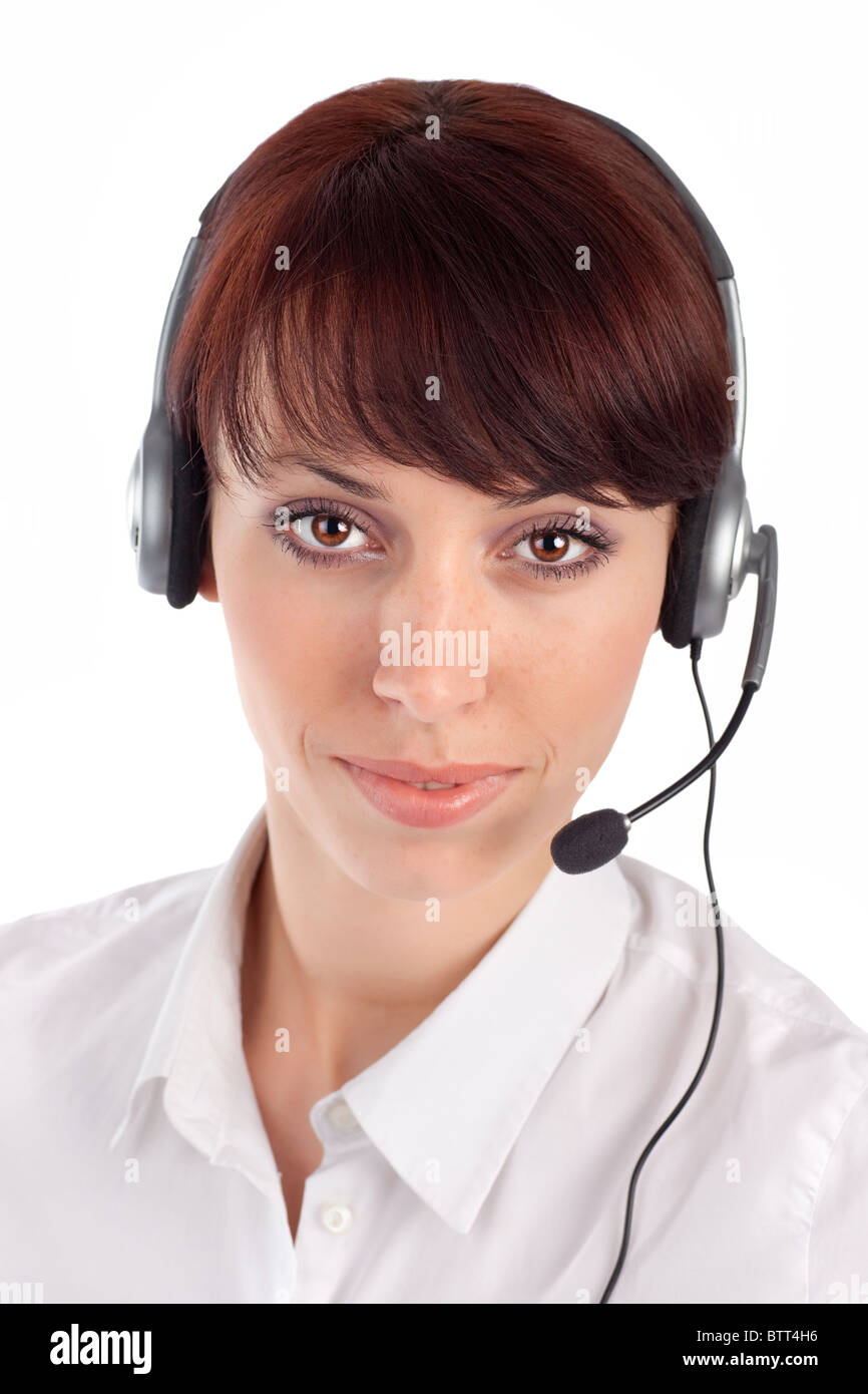 Friendly female customer service representative with headset, isolated on white background. Stock Photo