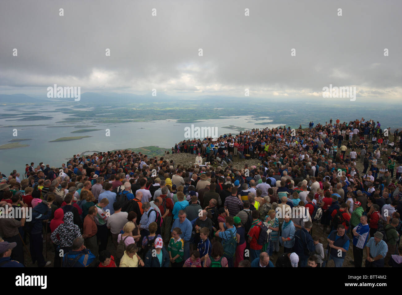 People praying on the top of Croagh Patrick a holy mountain in County Mayo, Ireland. - Stock Image