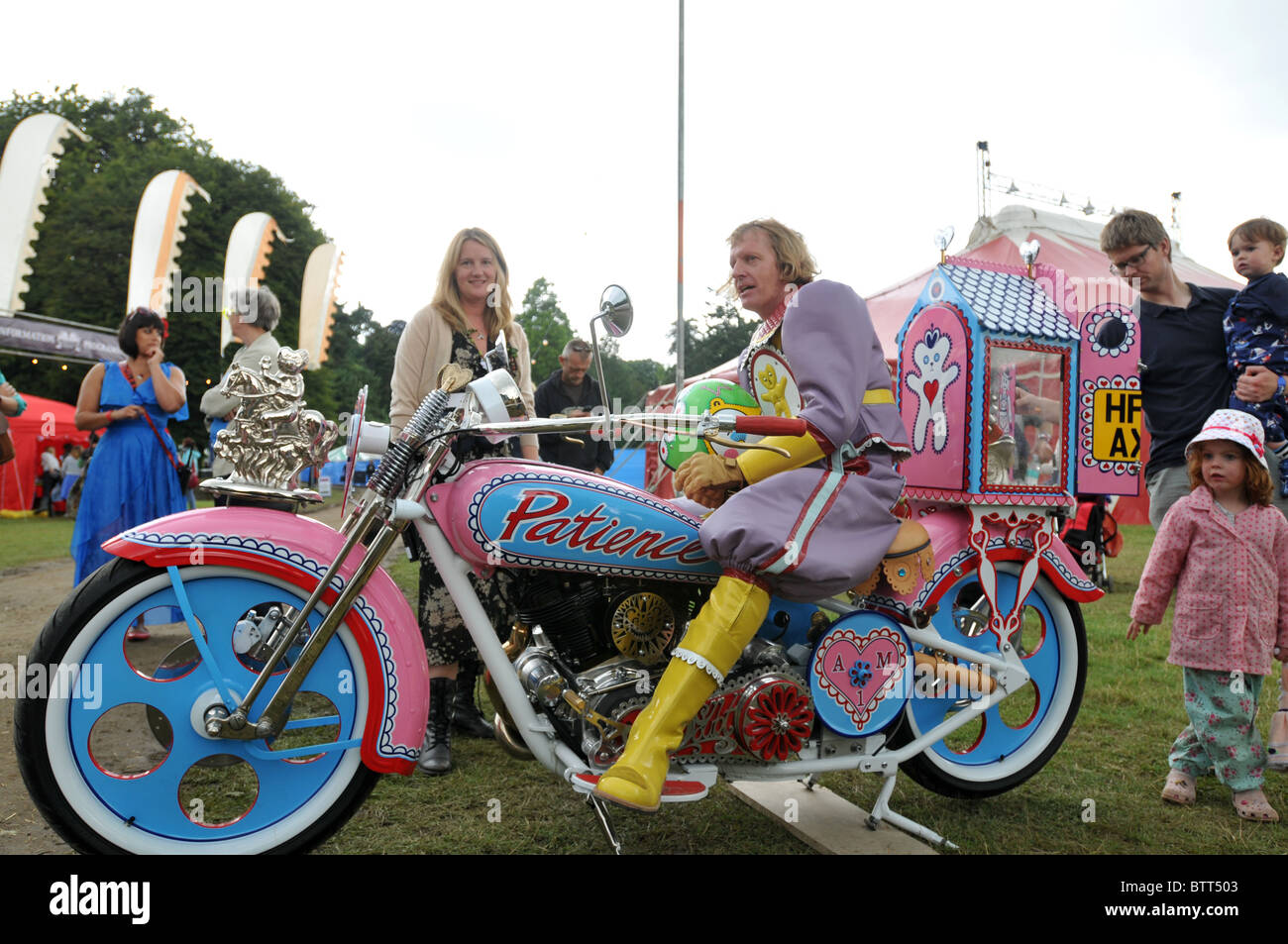Grayson Perry and Lady St Germans with motorcycle at the Port Eliot literary festival 2010 - Stock Image