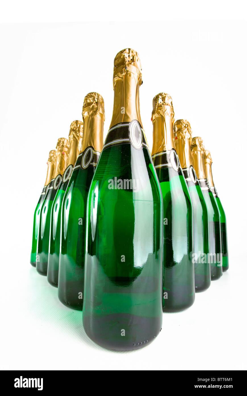 Sparkling wine bottles on a white background - Stock Image