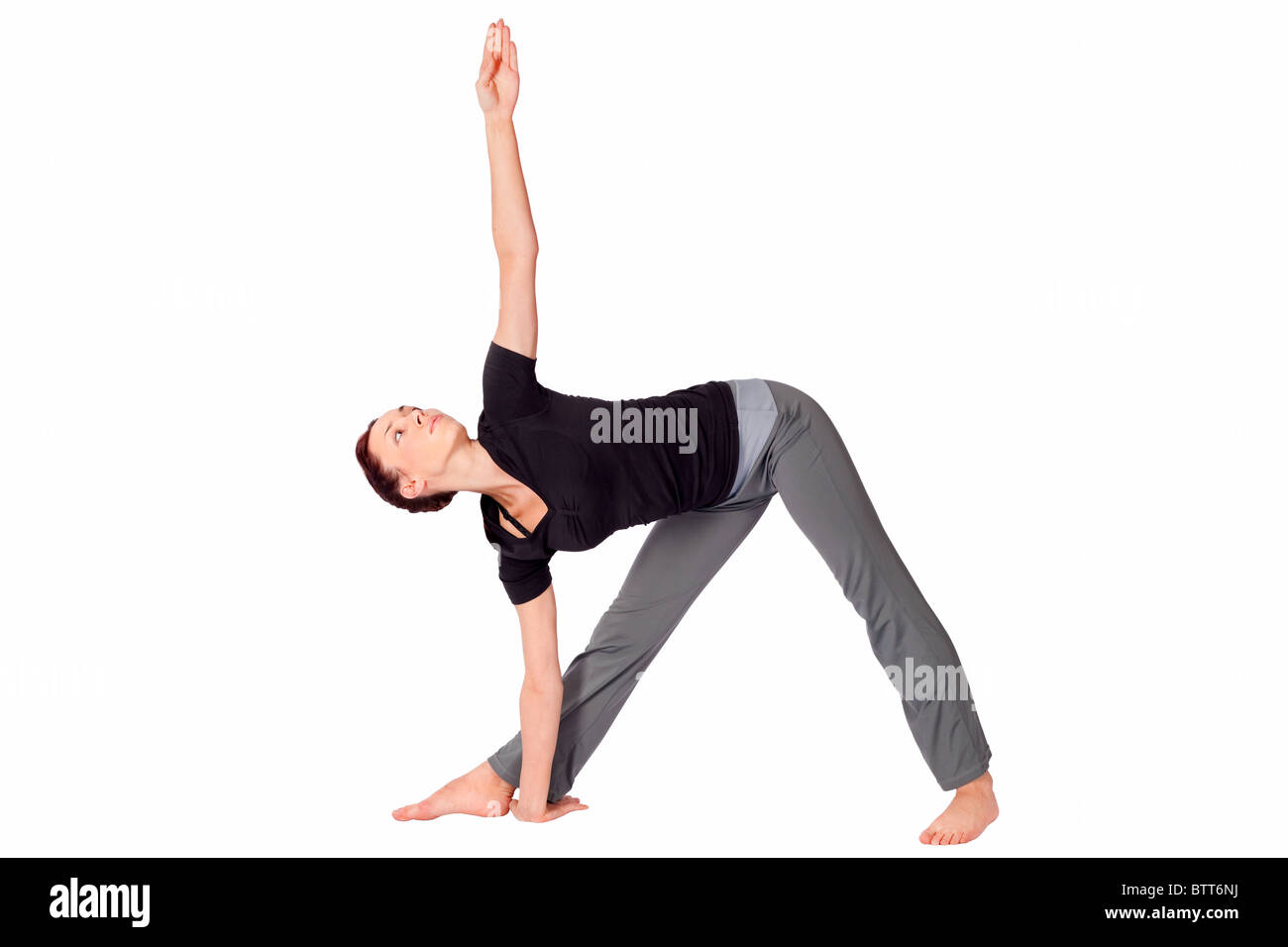 Young Fit Woman Doing Yoga Exercise Called Triangle Pose Sanskrit Stock Photo Alamy
