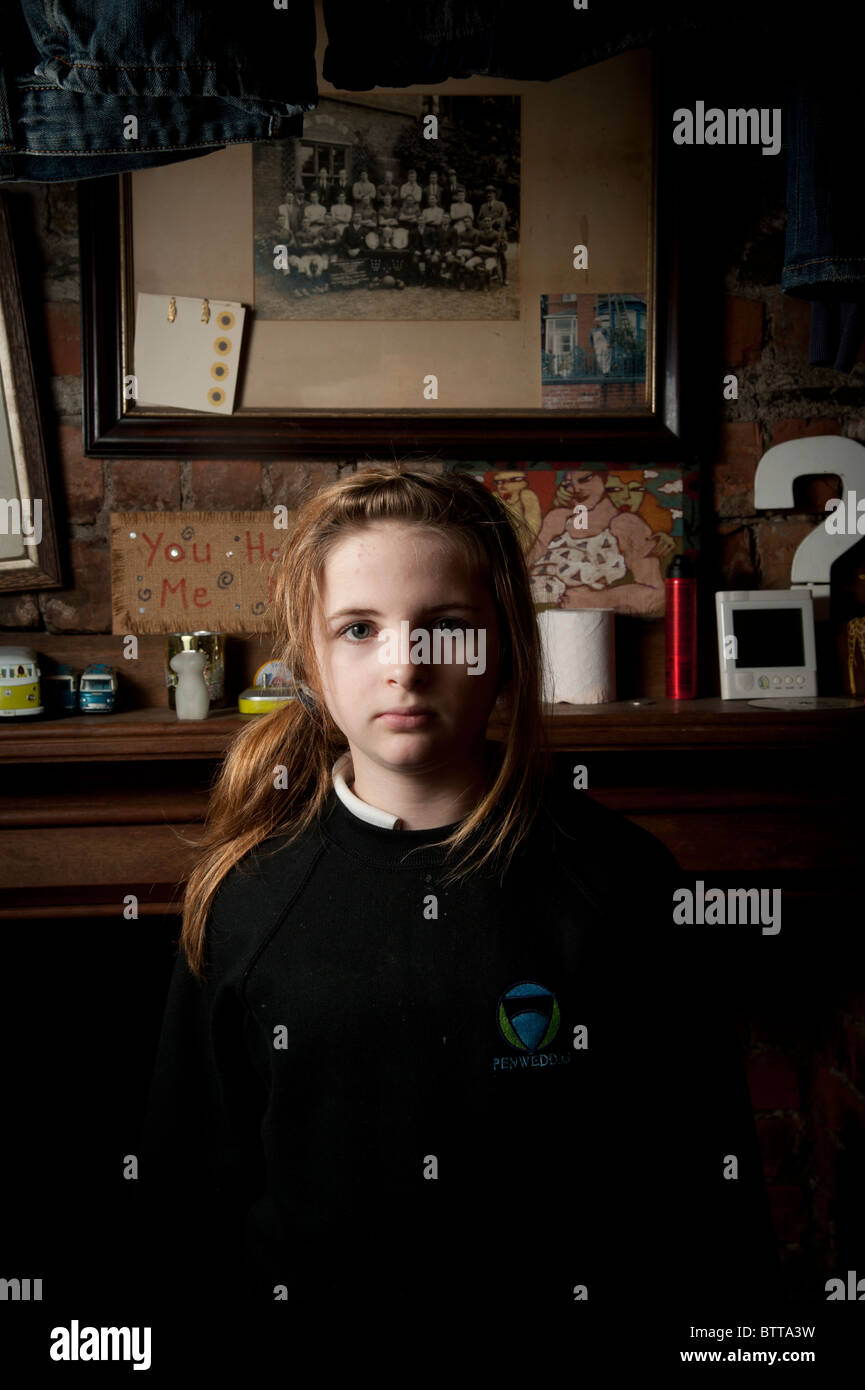 Interior, Sullen looking 12 year old girl, facing the camera, UK - Stock Image