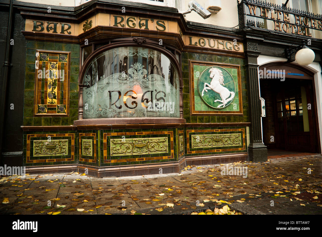 The old Victorian tiled frontage and engraved window of Rea's Bar lounge Aberystwyth Wales UK - Stock Image