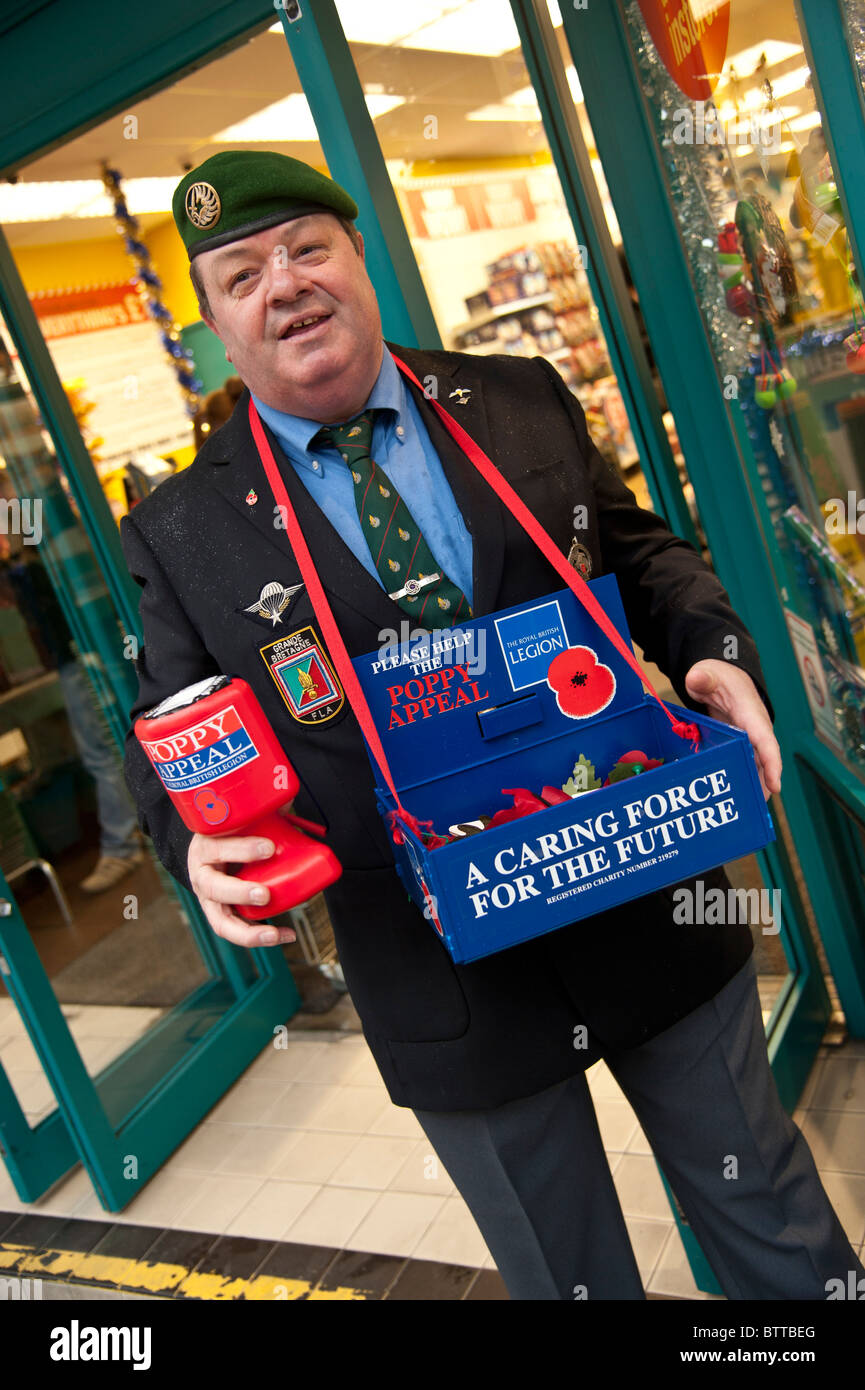 A former French Foreign Legion soldier selling Remembrance Day red poppies, UK Stock Photo