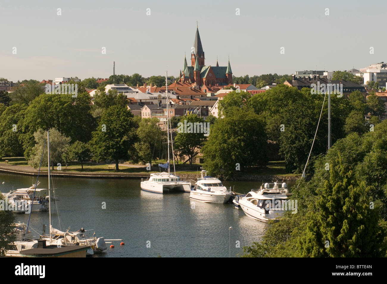 vastervik sweden swedish town city cites towns marina boat boats in harbor summertime summer yachts yacht sailing - Stock Image