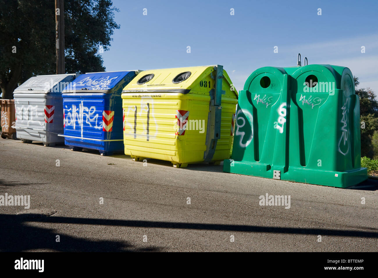 Full colored recycle garbage containers - Stock Image