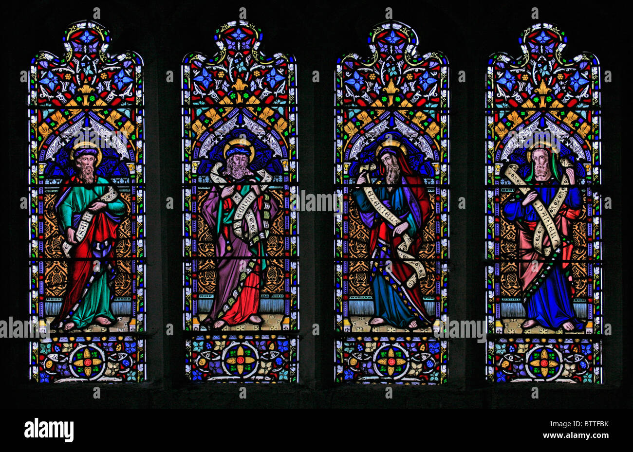 A stained glass window depicting Old Testament Prophets Isaiah, Jeremiah, Ezekiel and Daniel - Stock Image