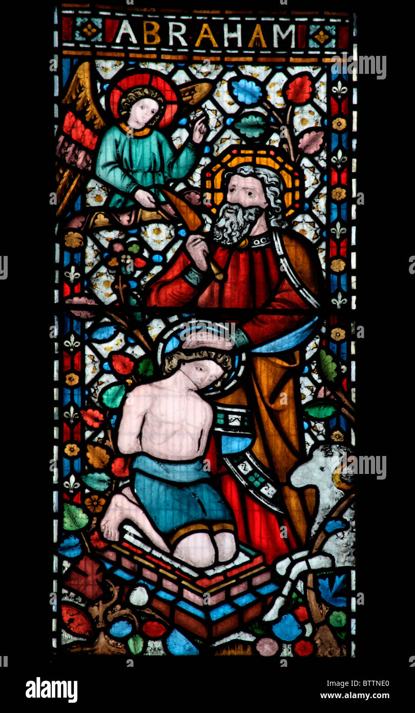 A stained glass window depicting The Angel intervening to prevent Abraham sacrificing his son Isaac - Stock Image