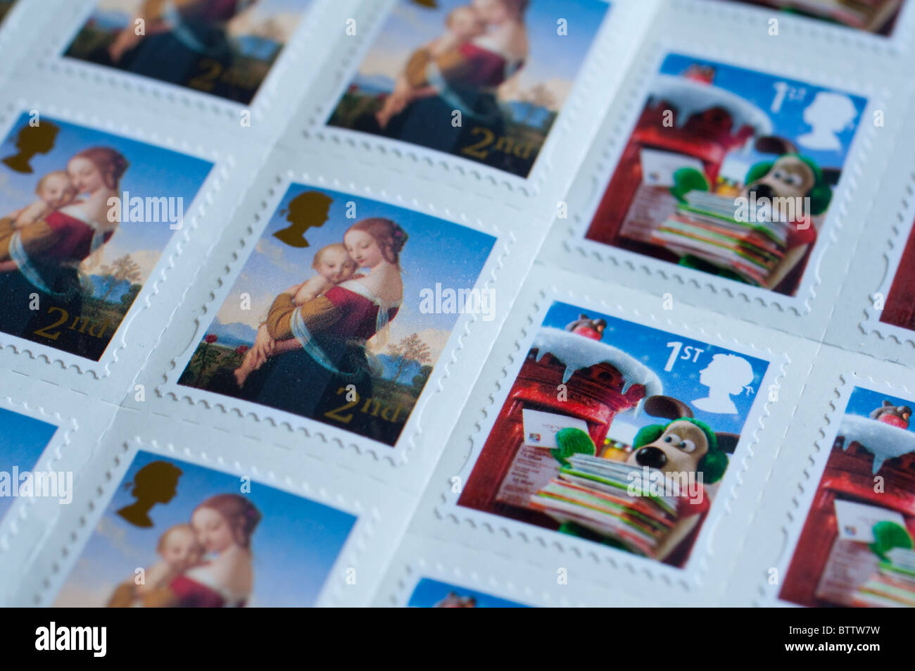 Christmas First and Second Class British Stamps. 1st Class - Wallace & Gromit; 2nd Class - Madonna and Child - Stock Image