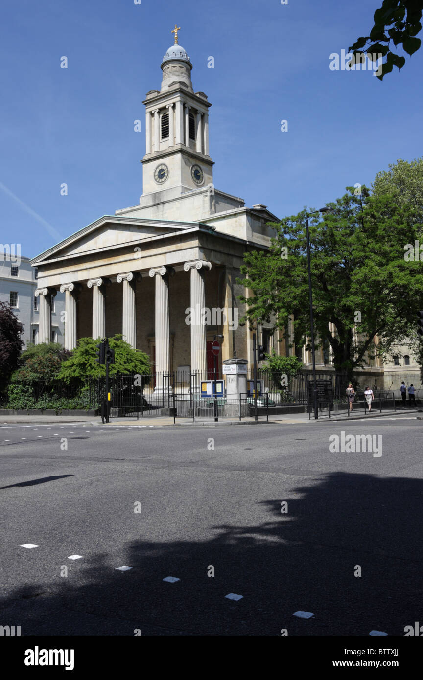 Situated at the most eastern end of Eaton Square in Belgravia, St Peter`s Church, an imposing building and portico. - Stock Image