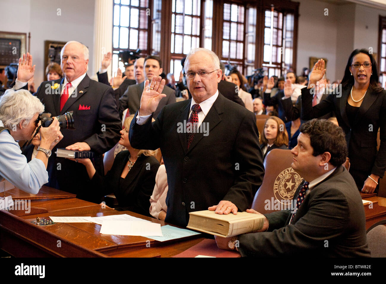 News photographer takes photo of legislator during swearing-in ceremony for members of the of the Texas House of - Stock Image