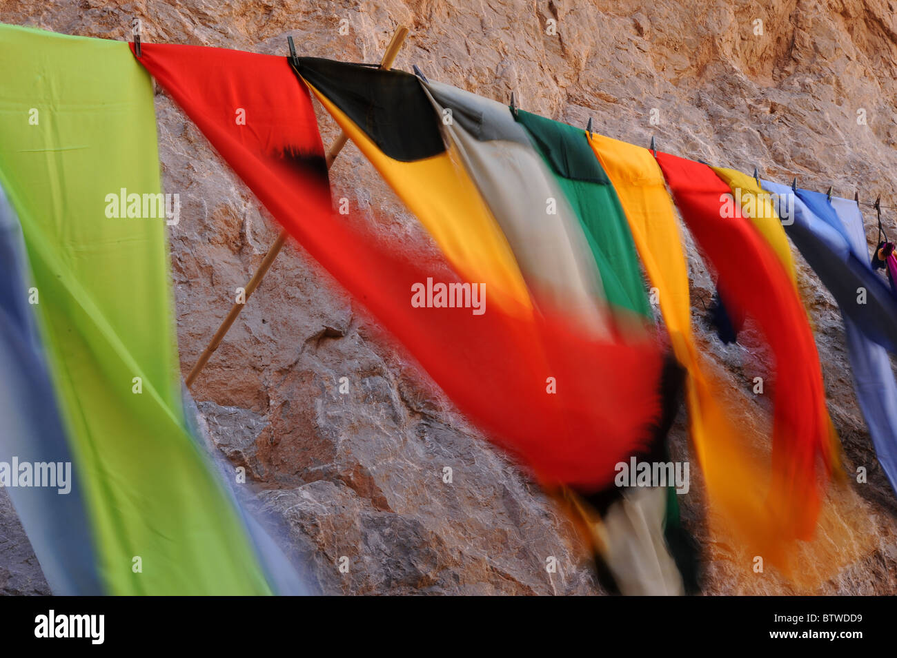 Brightly colored scarves for sale in the Todra Gorge, Southern Morocco. - Stock Image
