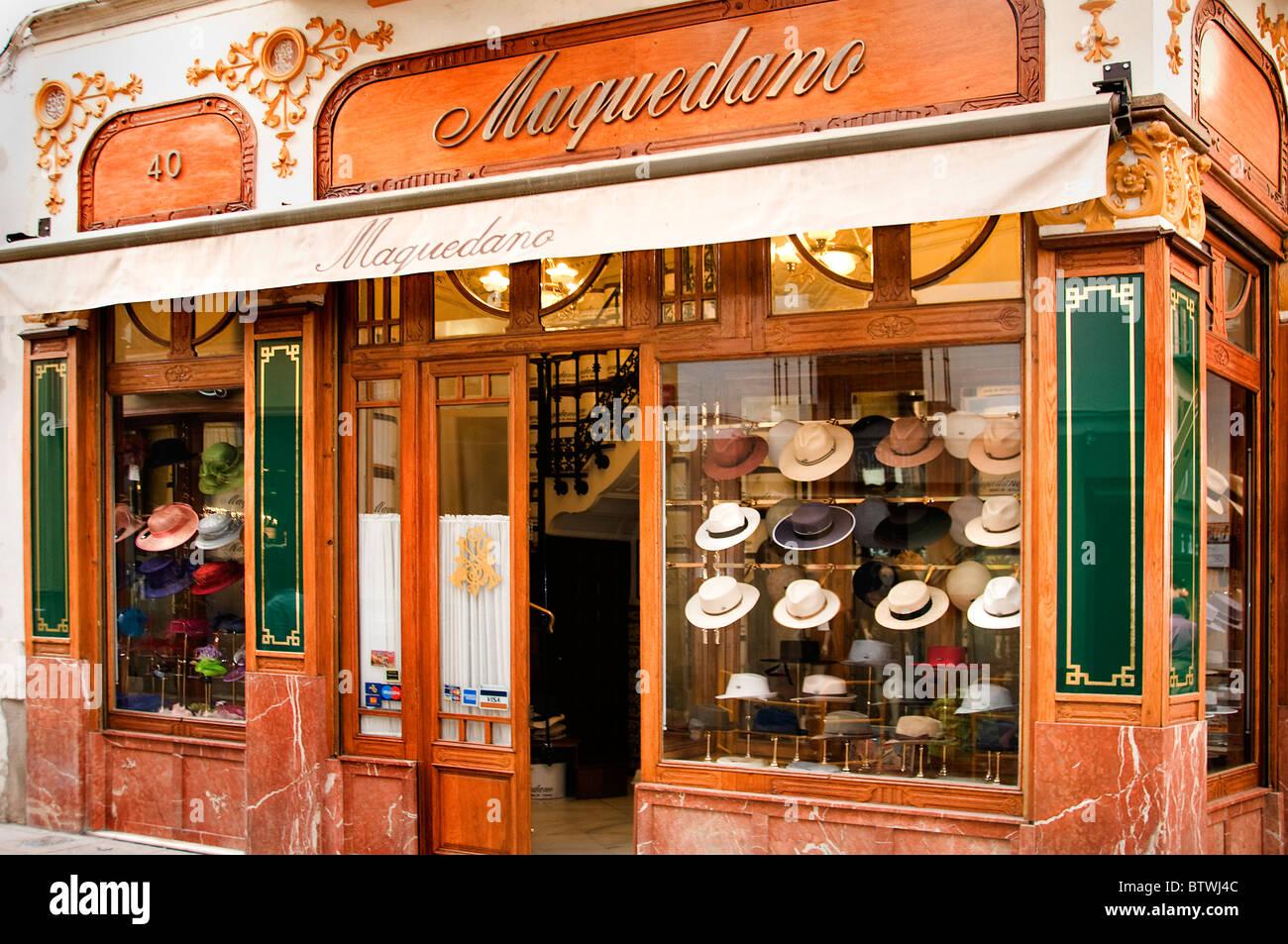 c24ce4fa77f Seville Spain hat shop cap hatter store window - Stock Image
