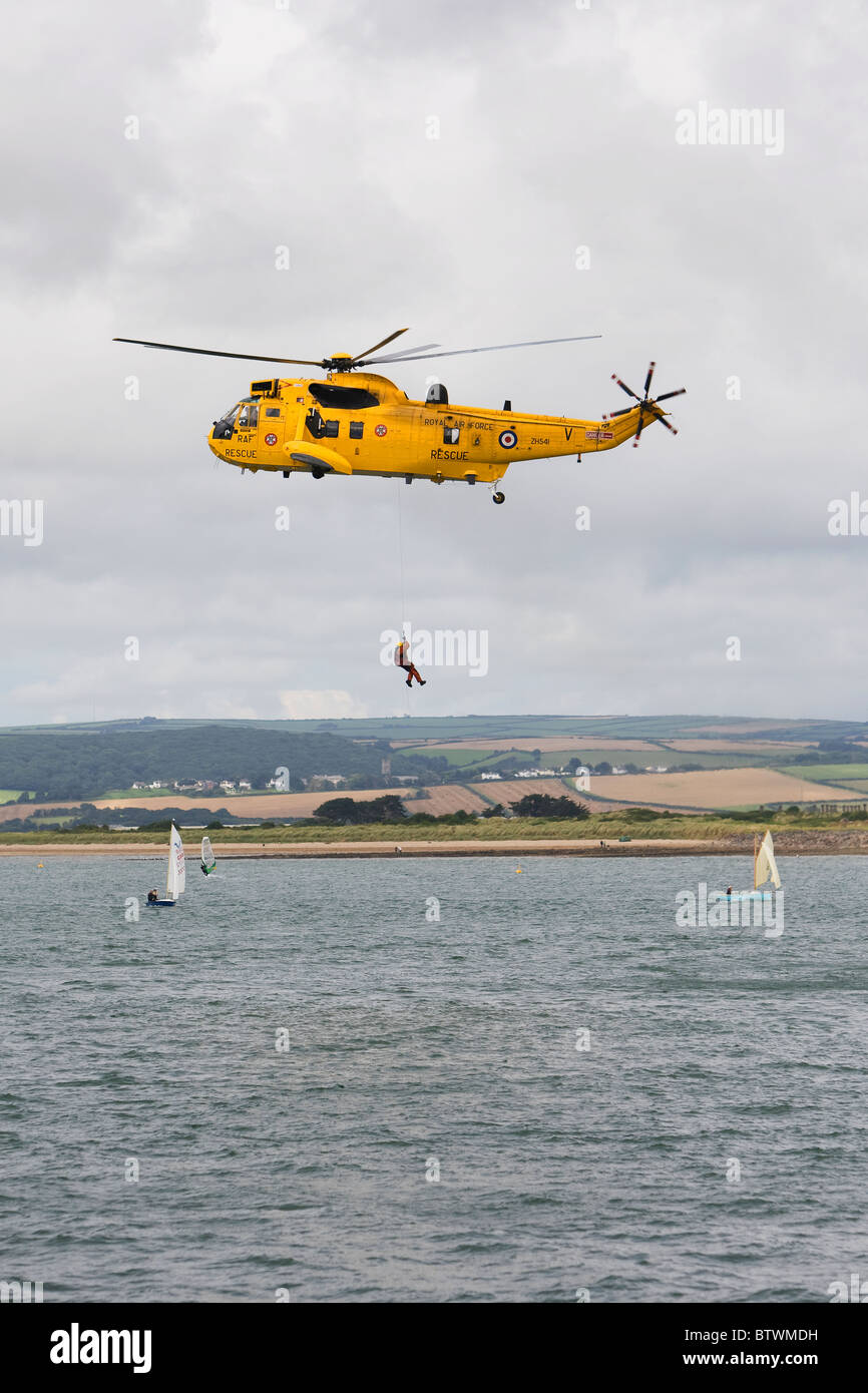 RAF Sea King search and rescue helicopter demonstration at Appledore regatta, North Devon, England - Stock Image