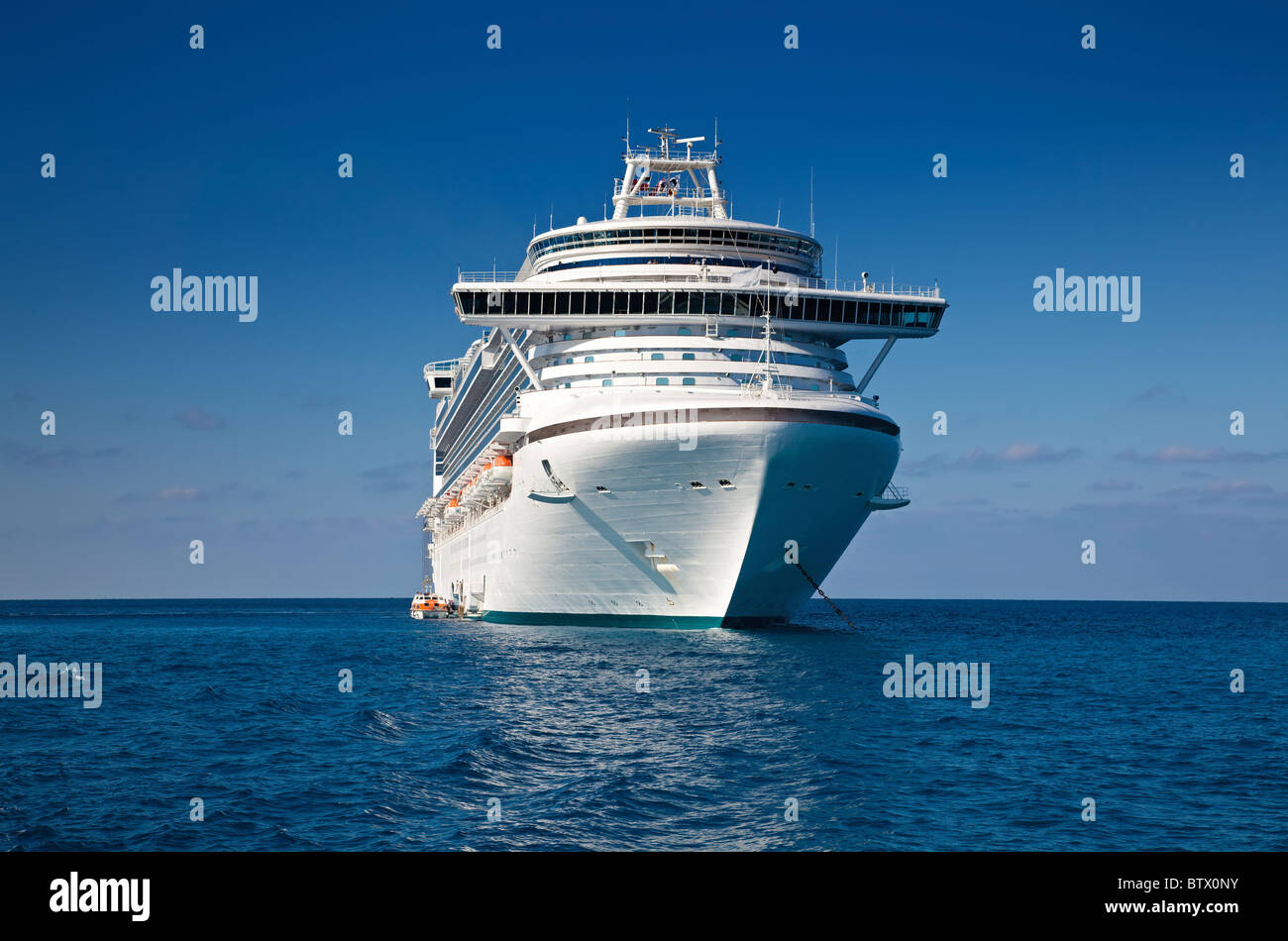 Cruise ship anchored in the Caribbean Sea - Stock Image