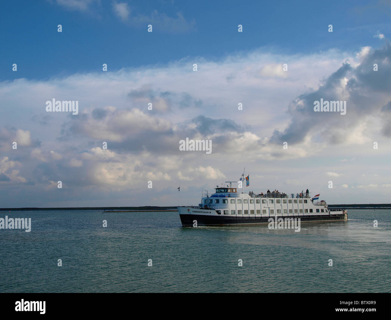 Tourism boat for guided tours to visit the Oosterschelde storm barrier, part of the giant Delta plan, Zeeland, the - Stock Image