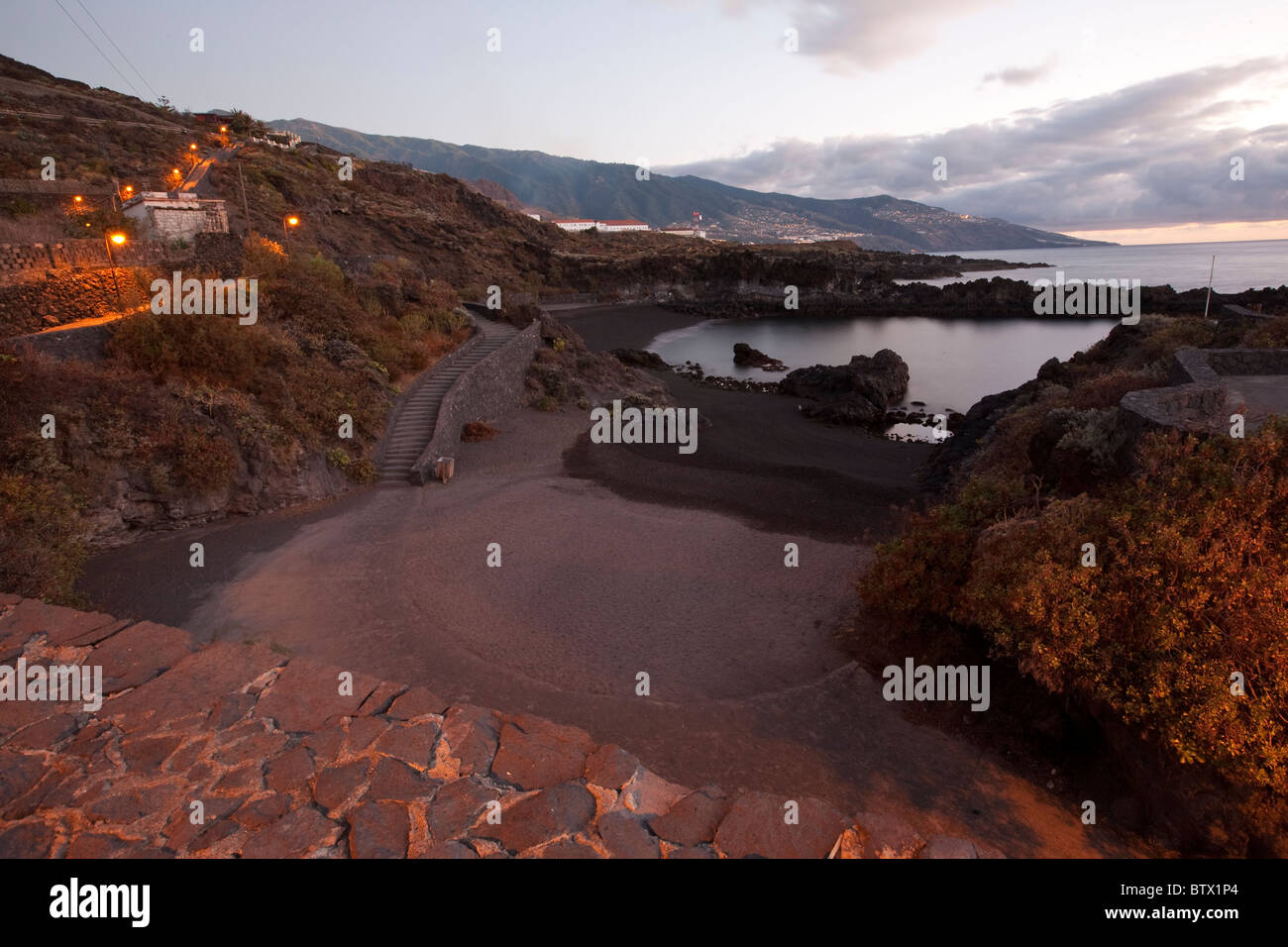 View point looking over the east coast and black sand volcanic beach at sun rise Los Cancajos, La Palma, Canary - Stock Image