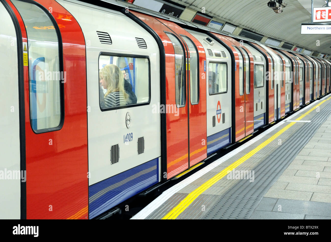 Southbound Victoria line train with doors closed Warren Street Station London England UK - Stock Image