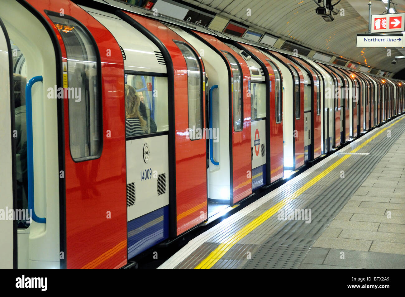Southbound Victoria line train with doors open Warren Street Station London England UK - Stock Image