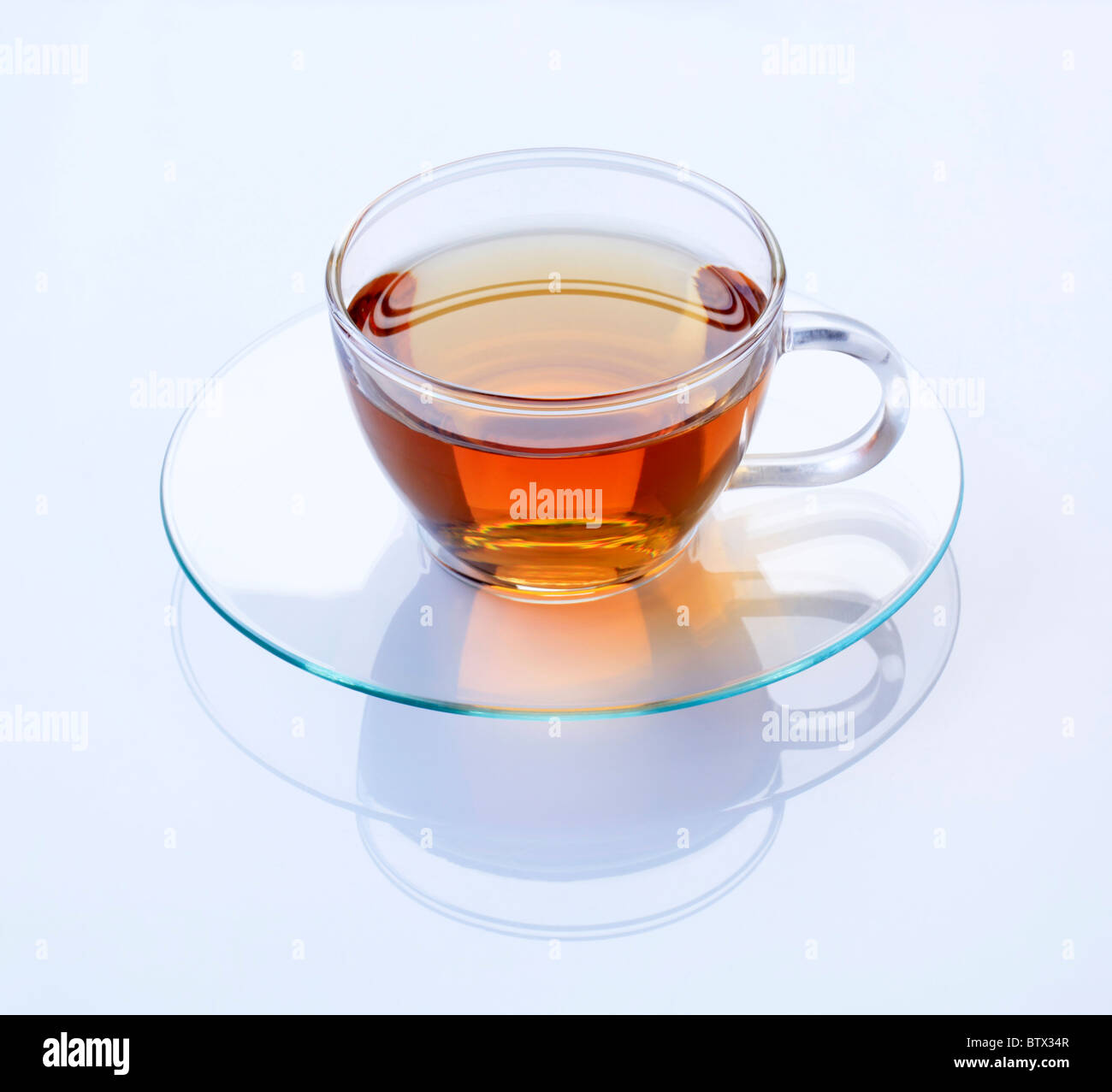 Hot black tea in a glass cup - Stock Image