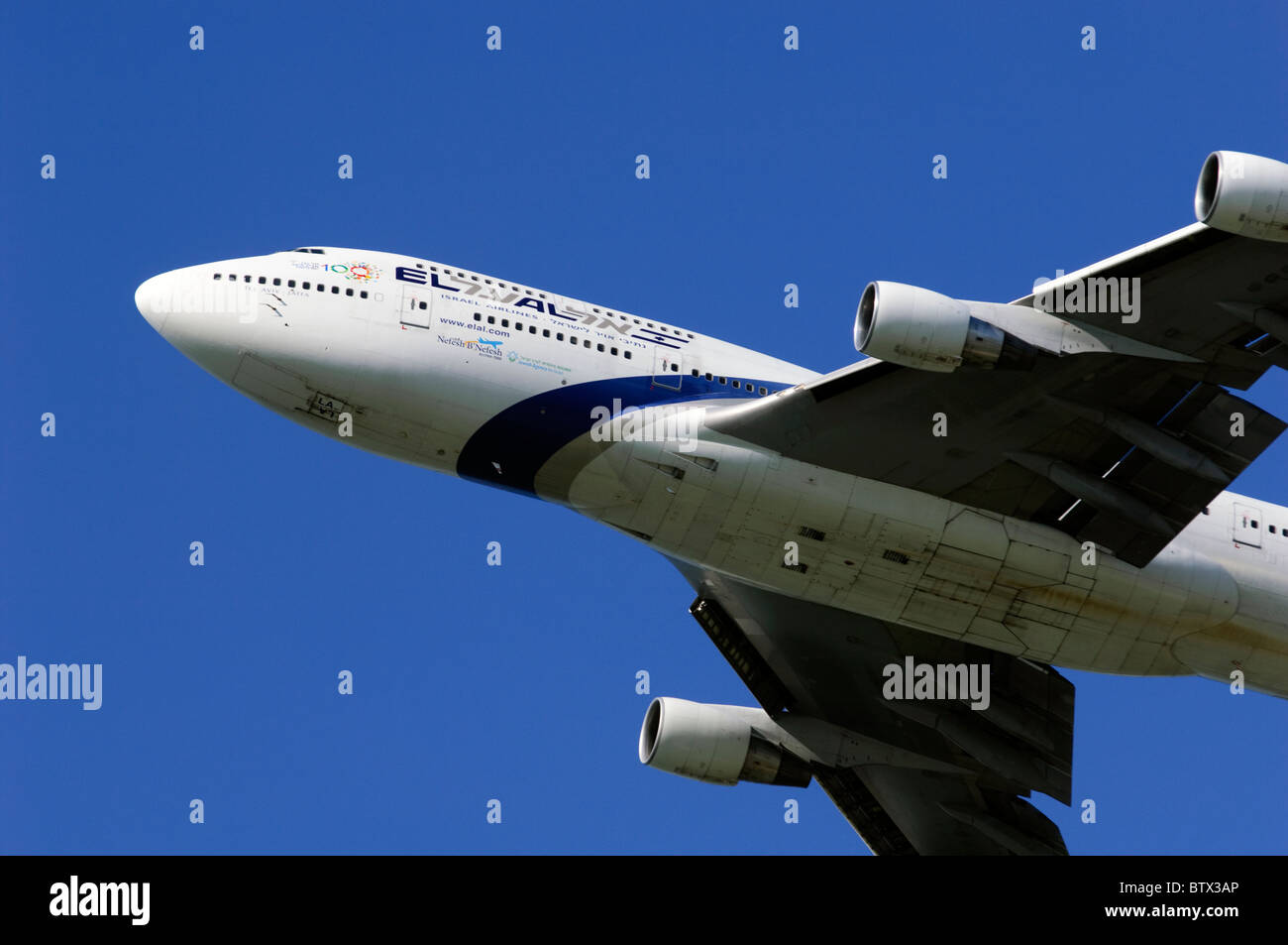 Boeing 747 Jumbo Jet operated by El Al climbing out after take off from London Heathrow Airport - Stock Image