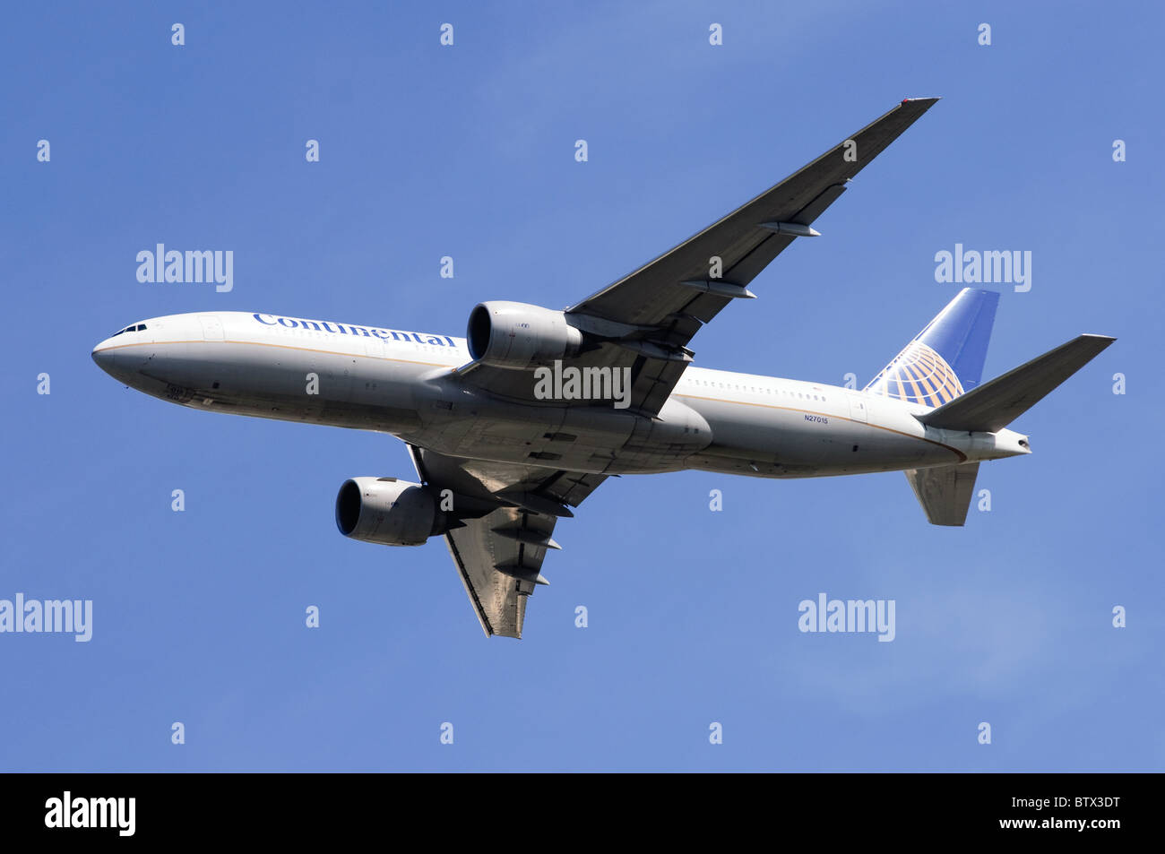 Boeing 777 operated by Continental Airlines climbing out after taking off from London Heathrow Airport - Stock Image