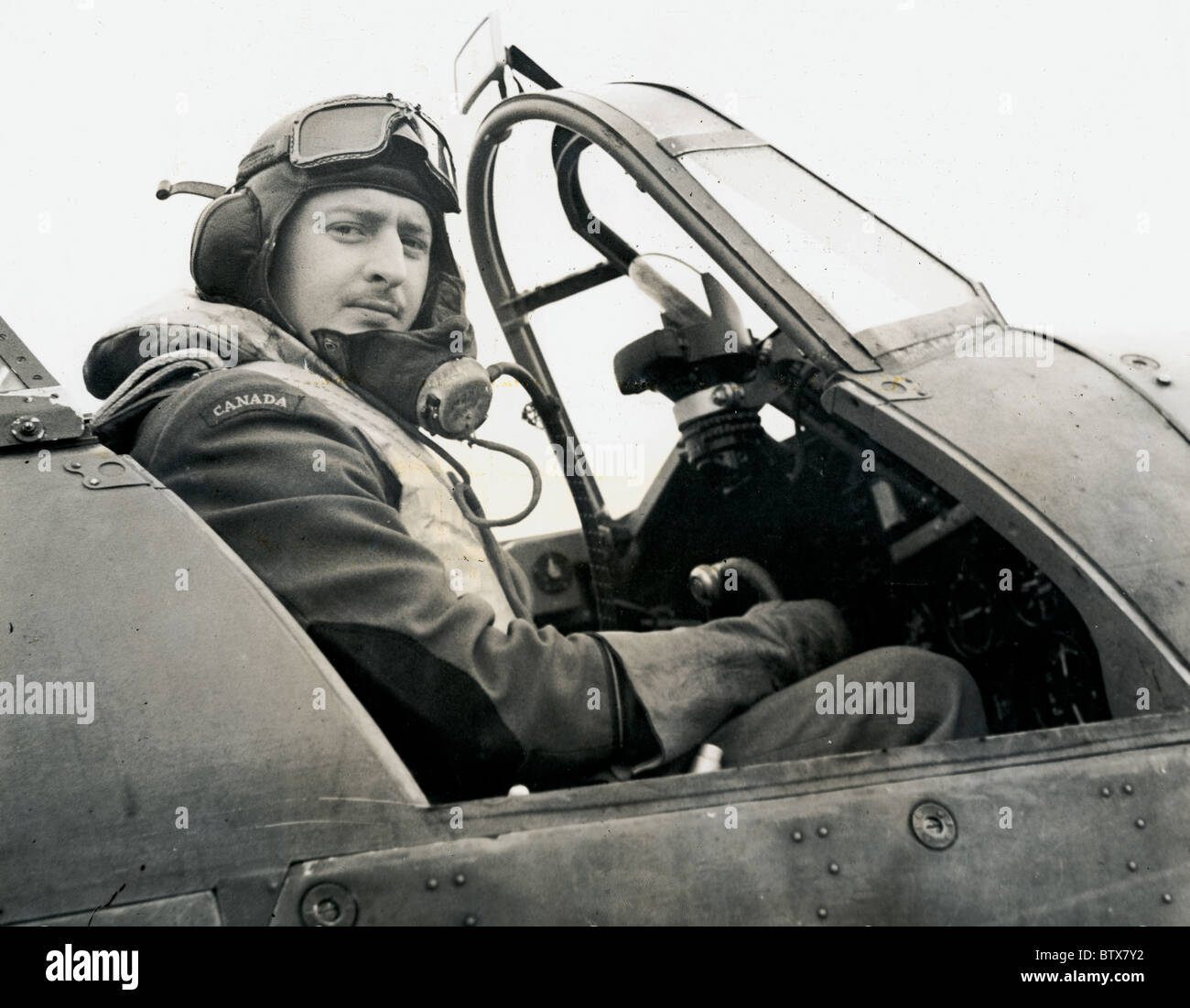 No.1 Royal Canadian Air Force Squadron Officer from Regina serving with RAF Fighter Command at controls of his aircraft - Stock Image