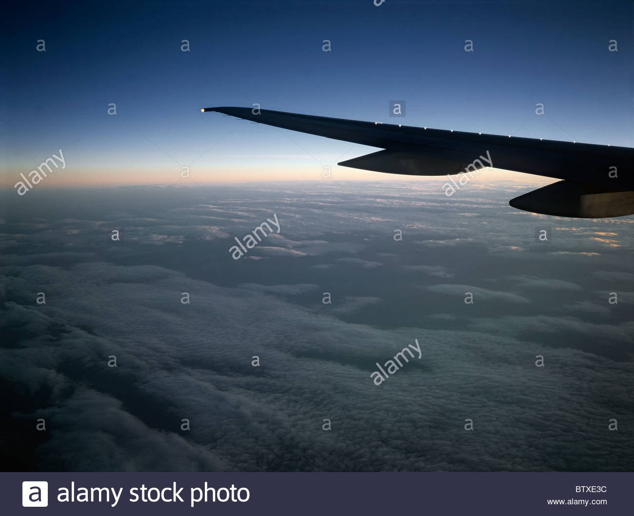 Flight over the Atlantic at Dawn Stock Photo