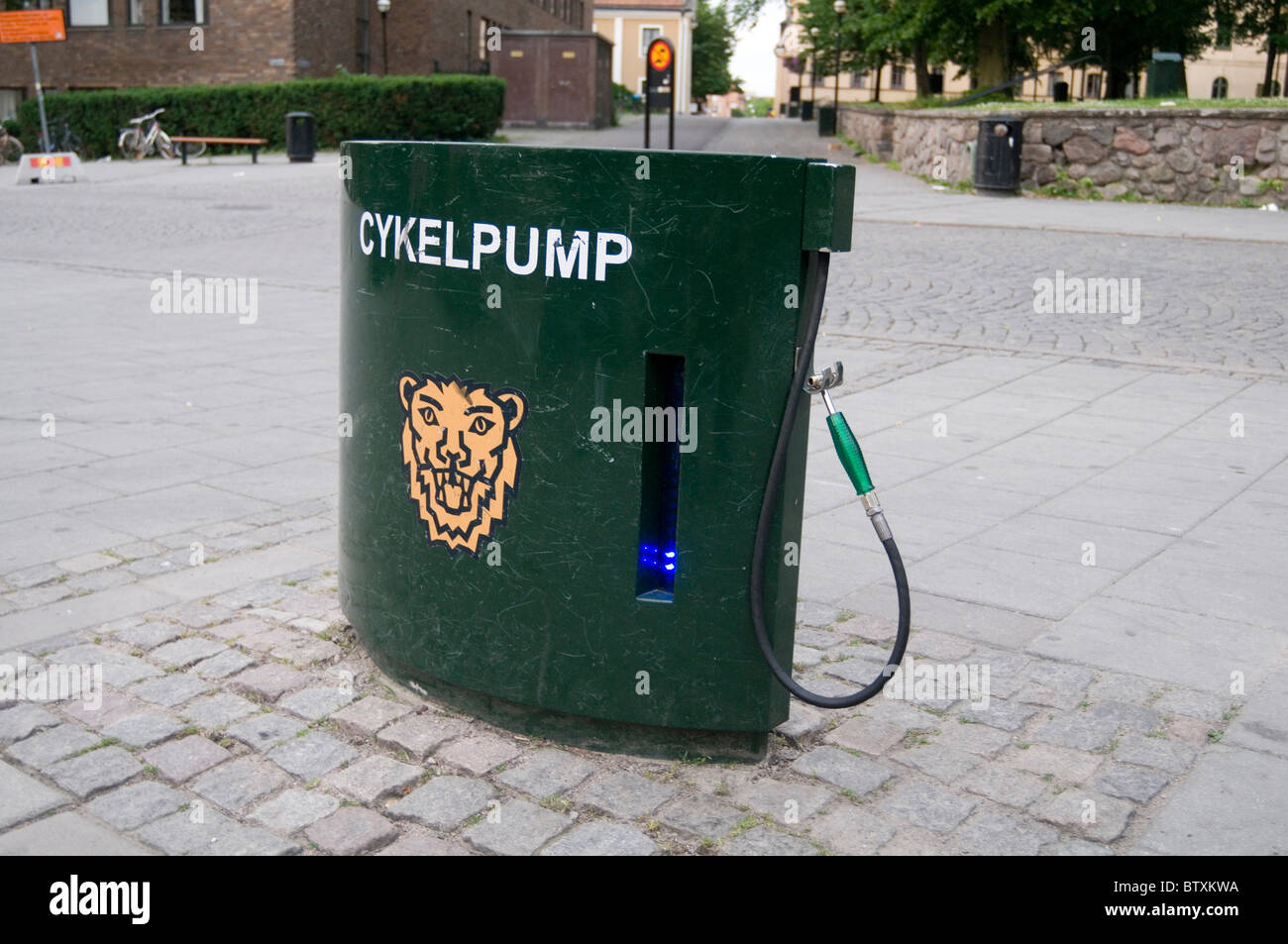 communal cycle pump bike tire tire inflation cykelpump pumps pumping up free air dispenser sweden swedish cycling - Stock Image