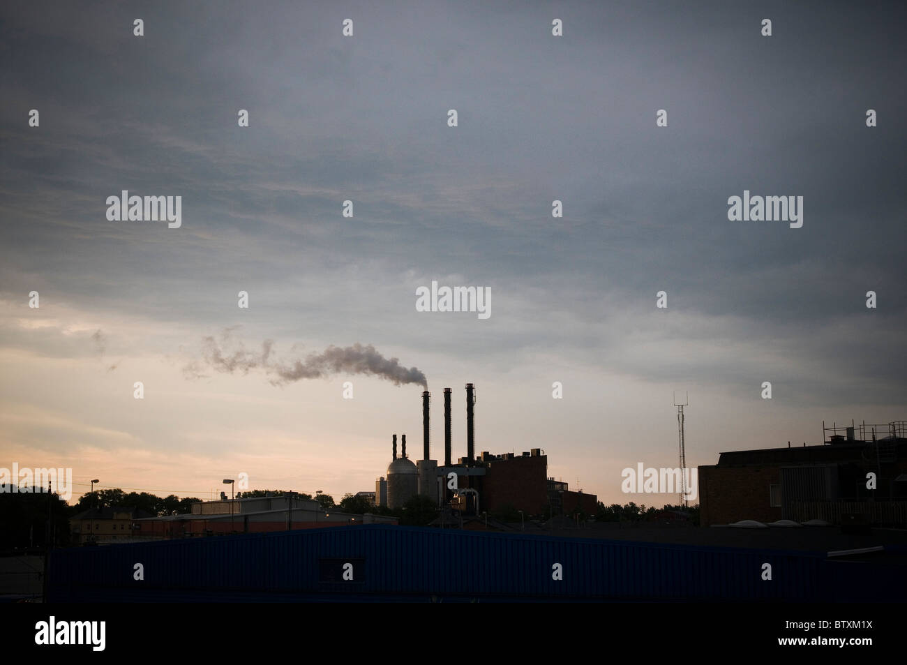 paper mill sweden swedish industry timber wood pulp factory factories smoke stack stacks chimneys chimney industry - Stock Image