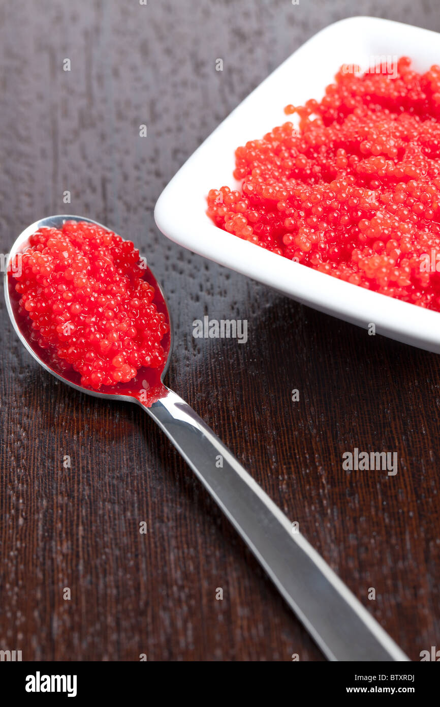 red caviar in spoon - Stock Image