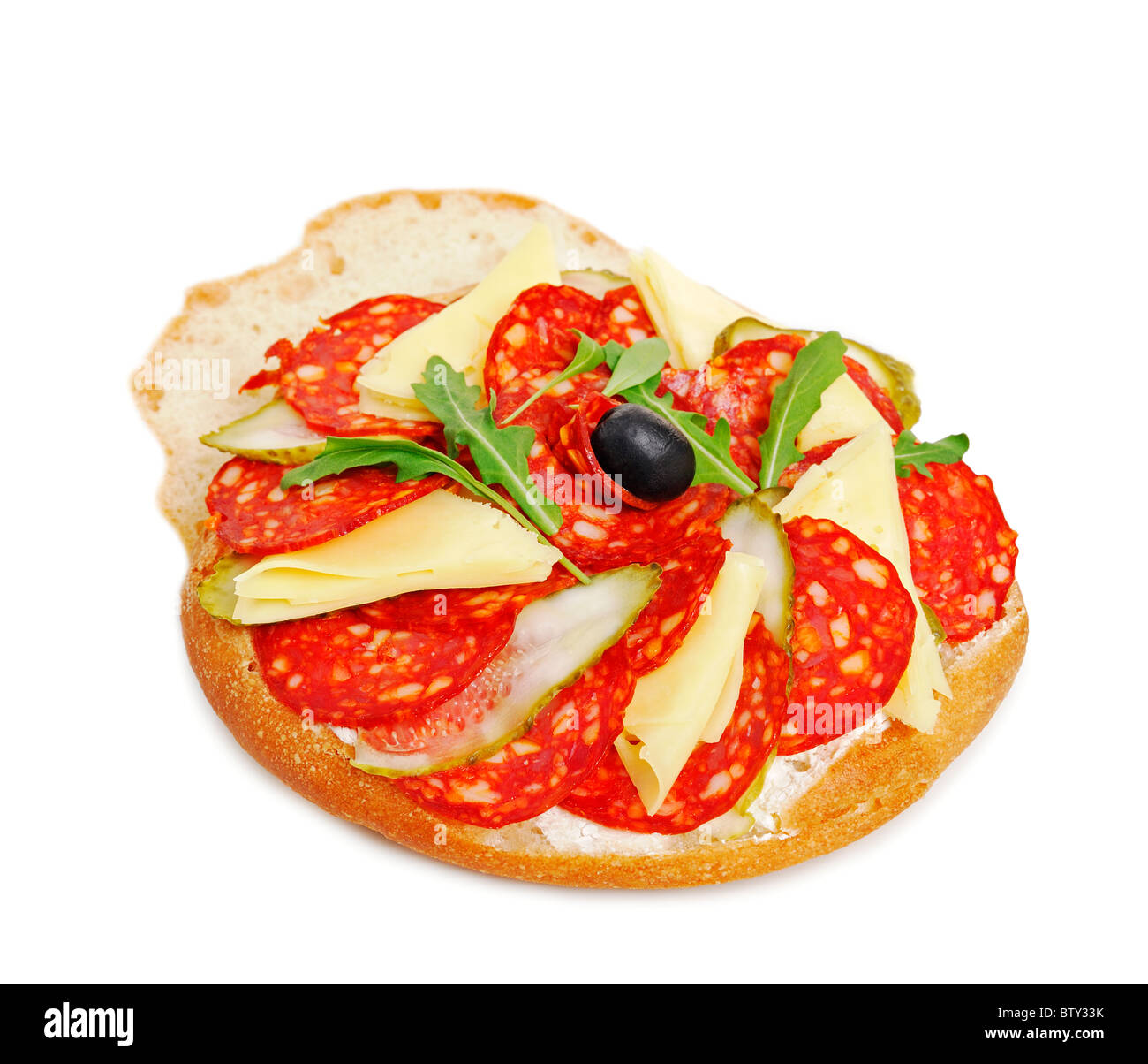 Salami Sandwich with Cheese and Garnish, Close Up. - Stock Image