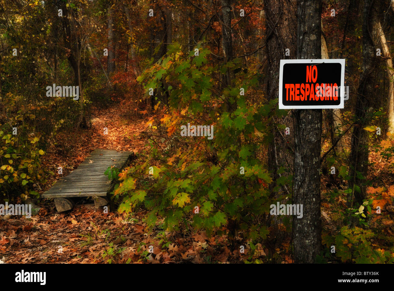 No Trespassing sign on a hiking trail - Stock Image