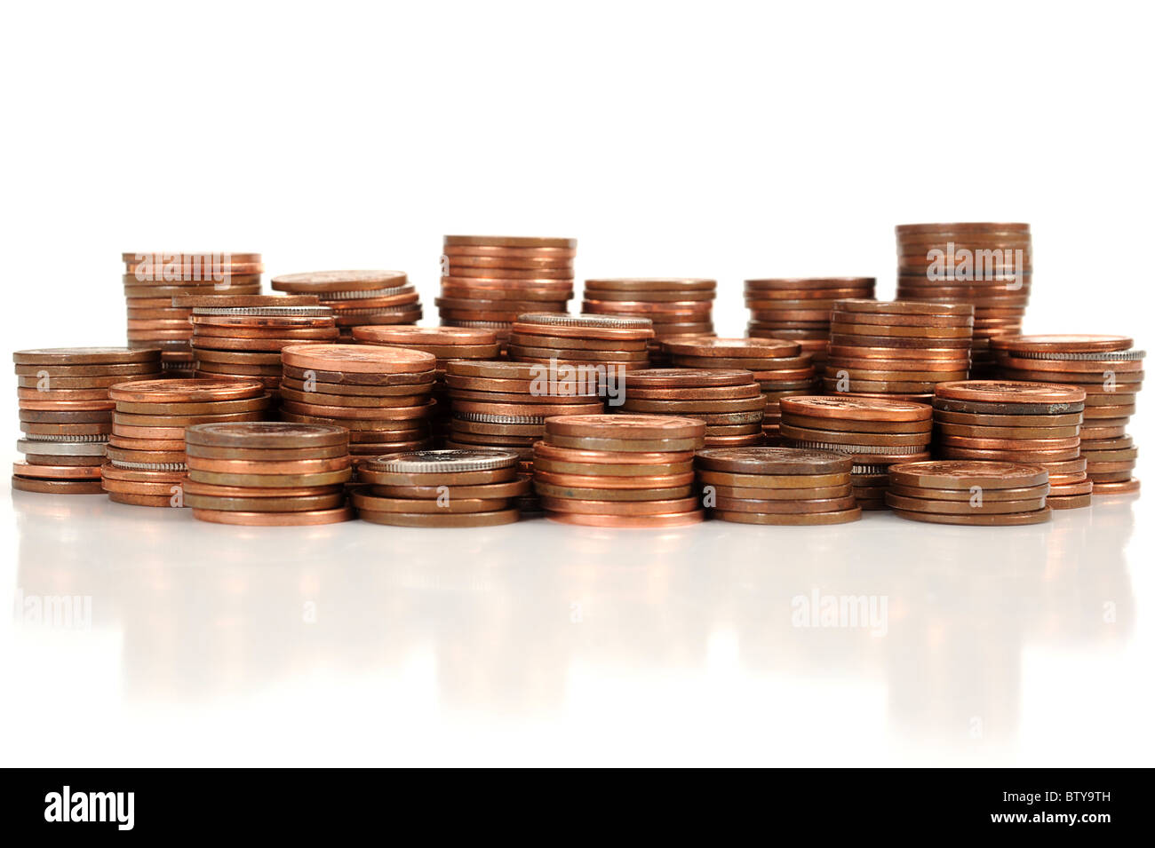 Pile of coins placed on white background - Stock Image