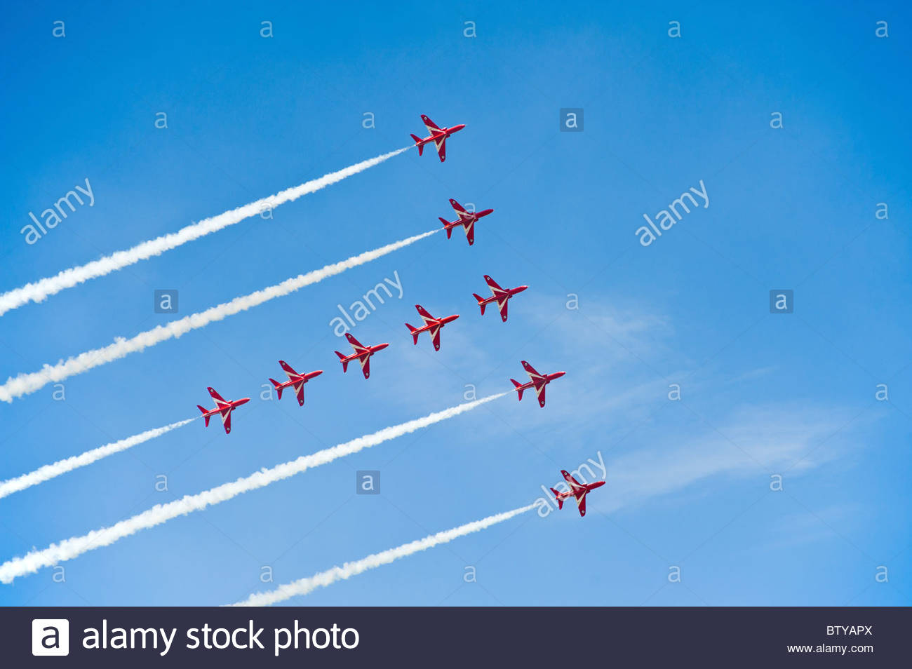 Red Arrows flying in formation, at Farnborough airshow 2010 - Stock Image