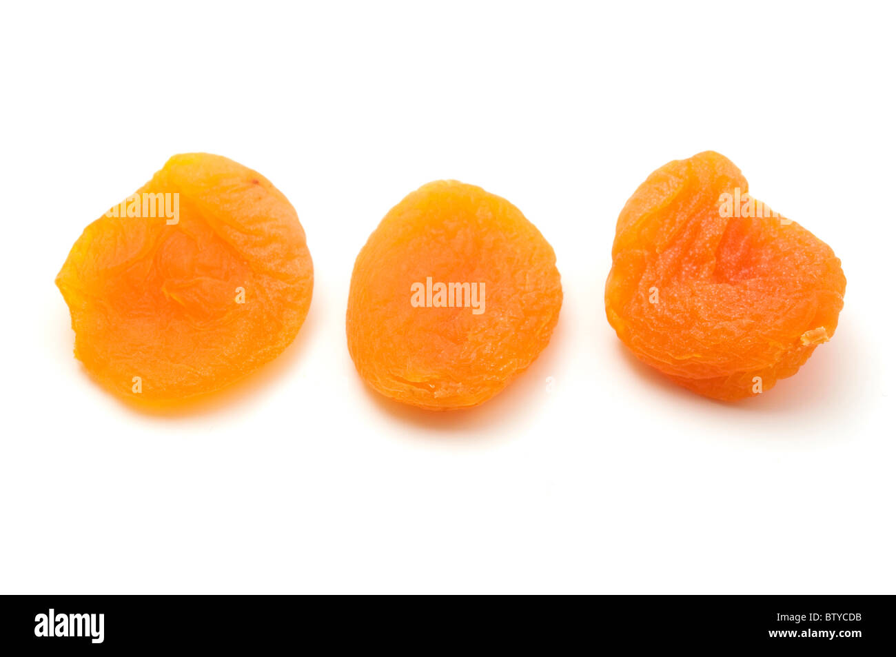 Dried apricots on a white background - Stock Image