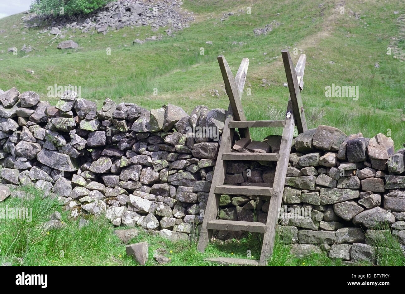Ladder Stile Over a Dry Stone Wall - Stock Image