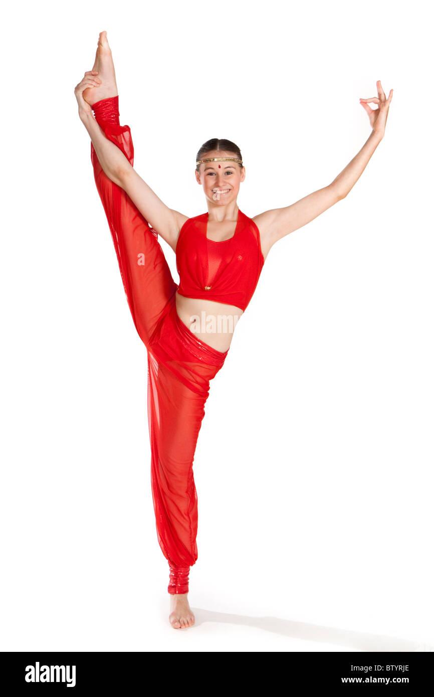 Studio shot of beautiful young girl in modern dancing costume - Stock Image