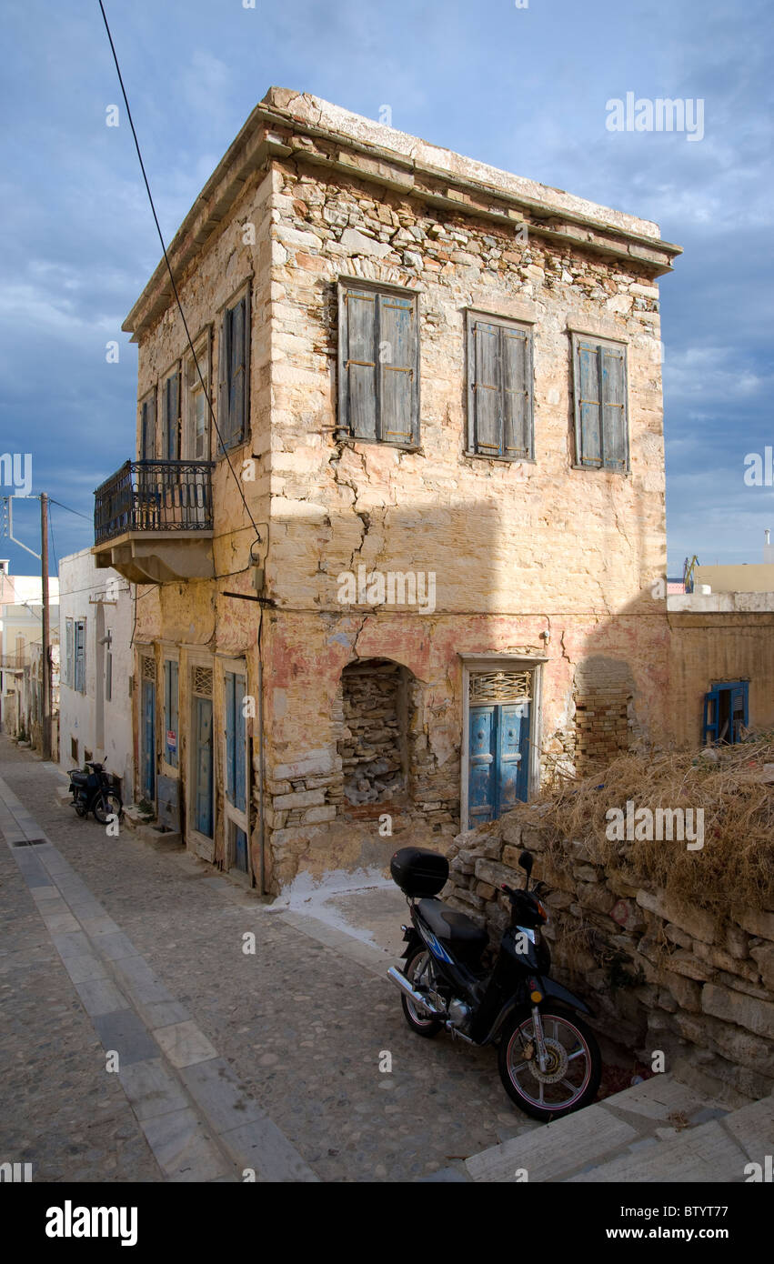 Old unoccupied  two storey house in Ermoupolis, on the Greek Cyclade island of Syros. - Stock Image