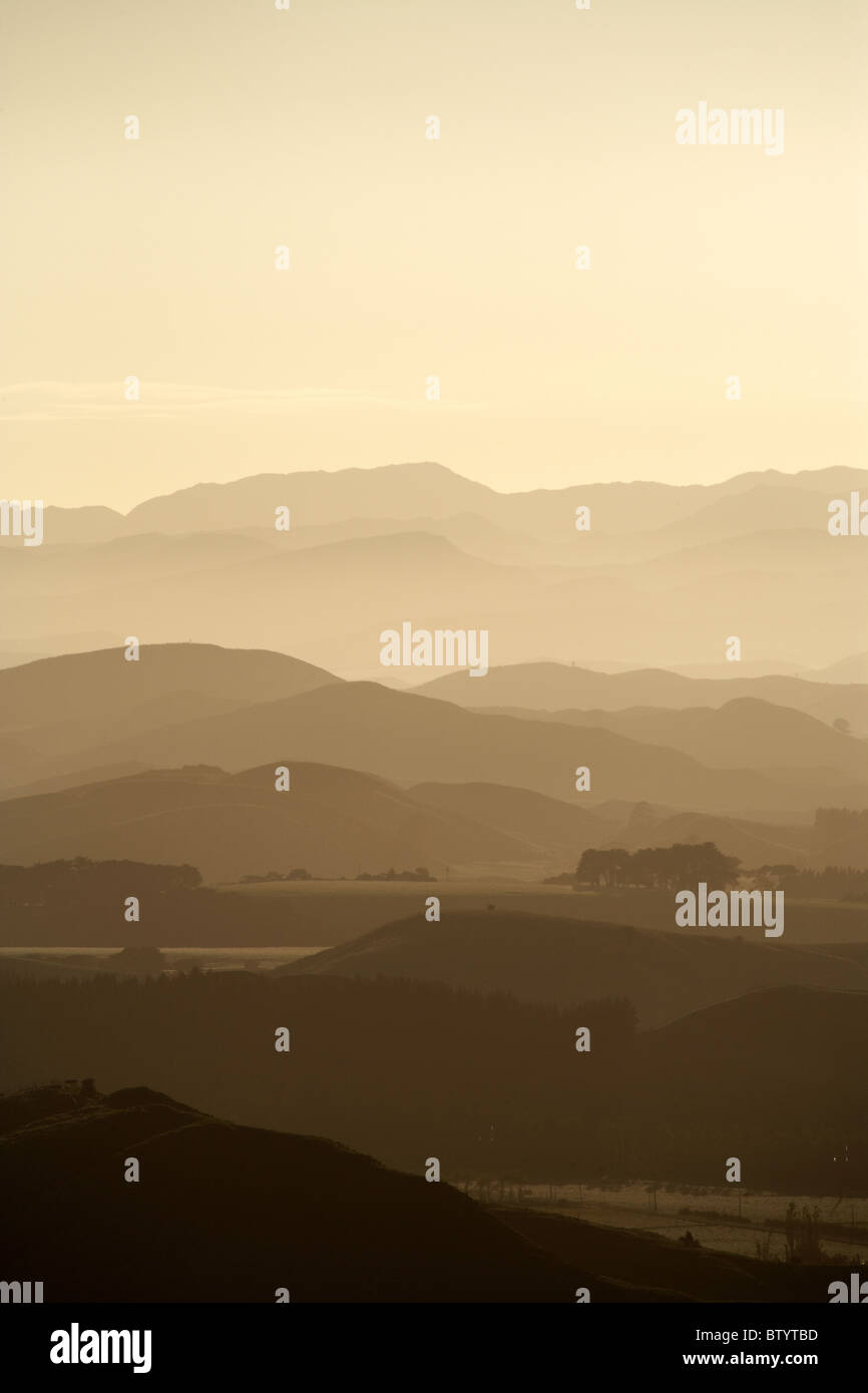 Early light over hills and farms near Woodville, Tararua District, Wairarapa, North Island, New Zealand - Stock Image