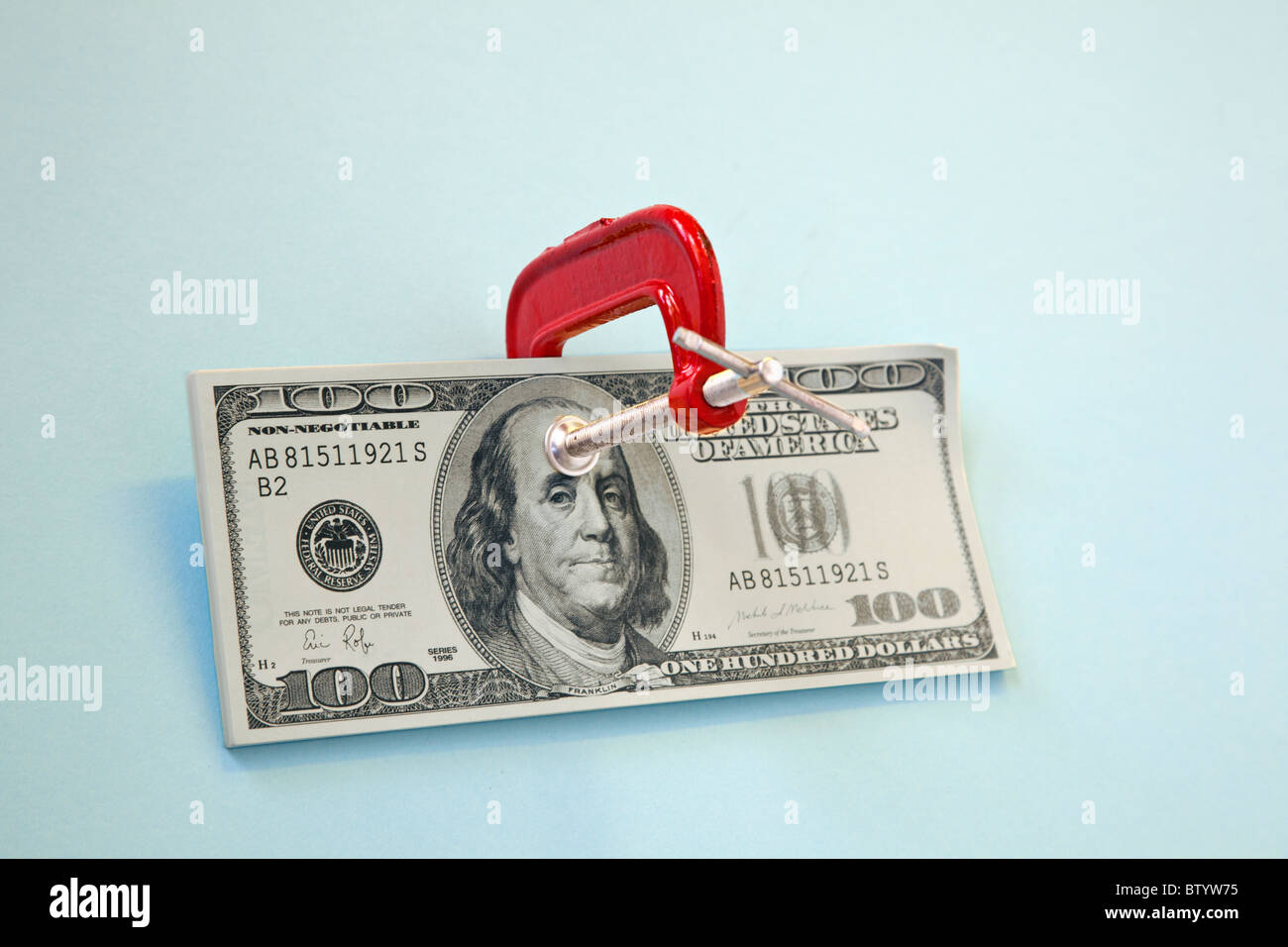 100 dollar bill with clamp on it - Stock Image