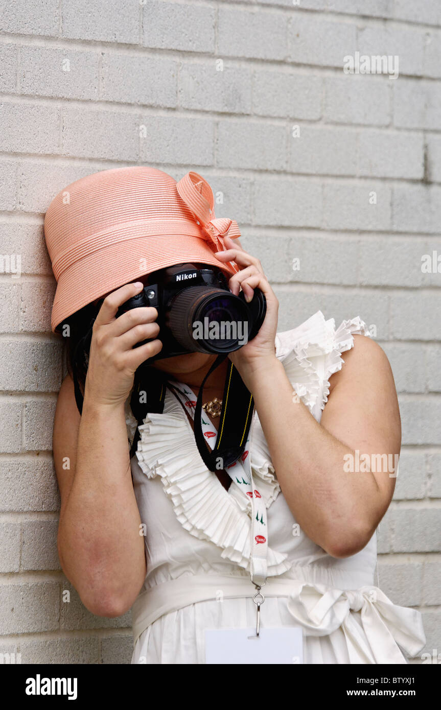 Photo of Woman Taking a Photo with a Nikon SLR Digital Camera at the 2010 Kentucky Derby in Louisville, Kentucky - Stock Image